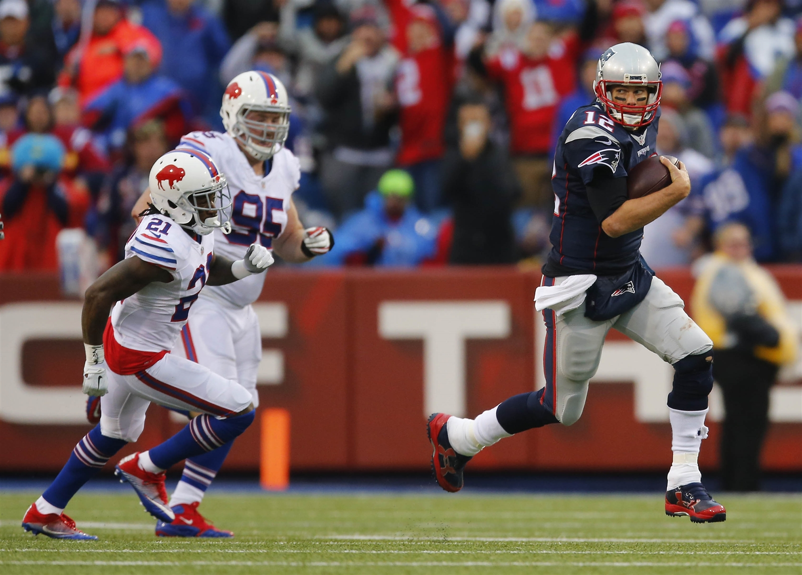 Tom Brady runs away from Bills defenders during the third quarter. (Mark Mulville/Buffalo News)