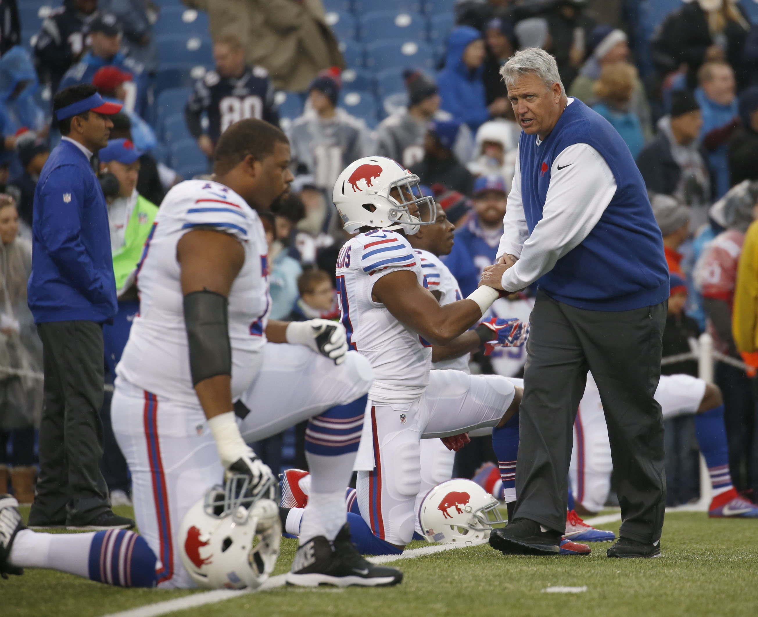 Rex Ryan meets with players prior to Sunday's game against New England. (Robert Kirkham/Buffalo News)