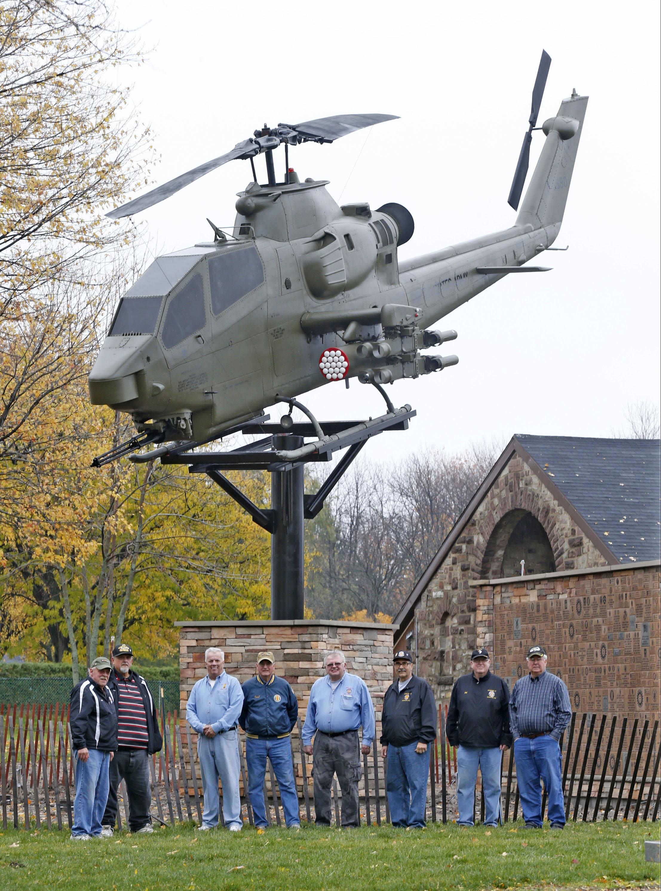 U.S. Army Vietnam War veterans stand near the 1972 Cobra helicopter that was erected in Veterans Park in the City of Tonawanda on Thursday, Nov. 3, 2016. From left are Michael Walker, Tom Thompson, Dan Brady, Paul Pietrowski, Ed Bodine, Pete DiVergilio, Bill St. Jean and Dennis Smilinich. (Robert Kirkham/Buffalo News)