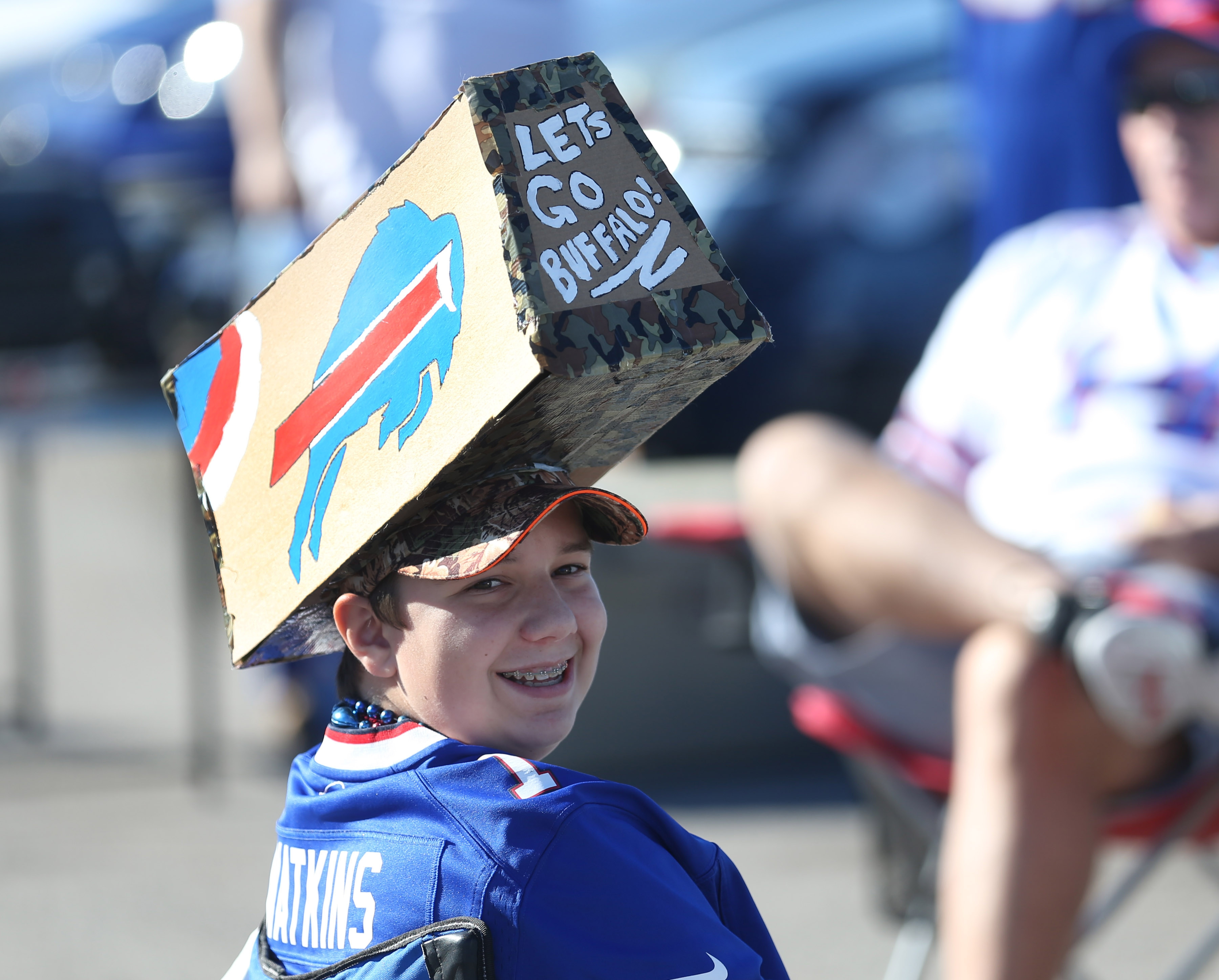 Tailgating before a Buffalo Bills game is an integral part of game-day fun around New Era Field, in Orchard Park. Tailgaters bring an array of food and drink and visit with their neighbors prior to game time, Sunday, Sept. 25, 2016. Jacob Lawson, 14, of Batavia, makes a funky hat for his first Bills game. (Sharon Cantillon/Buffalo News)