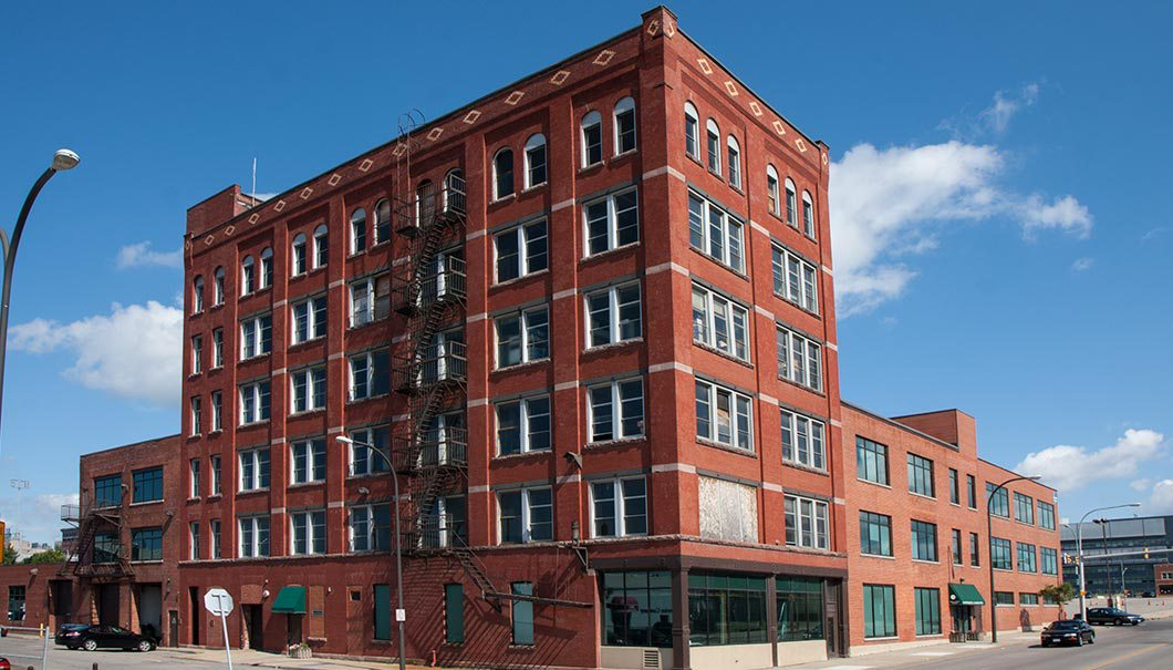 Ellicott Development is seeking tax breaks to convert the former Buffalo Envelope building into offices, warehouse space and apartments. (Google)