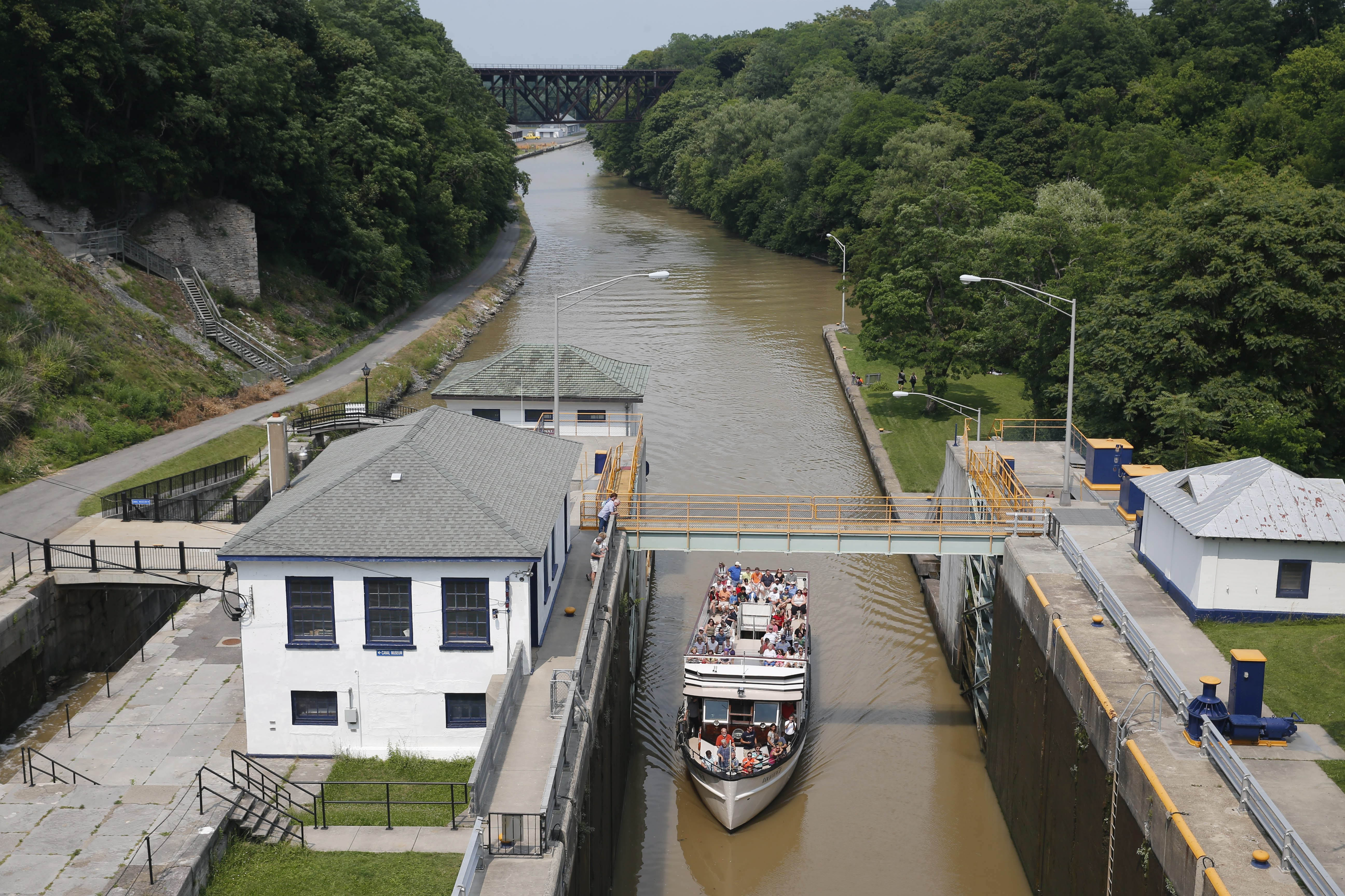 A tour boat, Lockview V, enters a lock while taking tourists up the Erie Canal in Lockport. A tour boat operator called Hydraulic Race Co. plans to open the first zip line attraction over the canal on May 1, 2017.