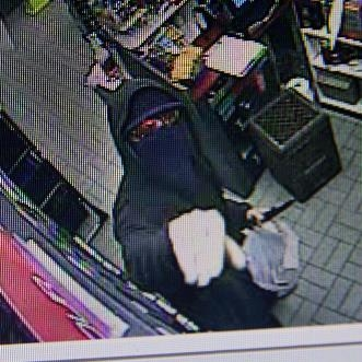 Surveillance image of suspect in Lockport Sunoco robbery.