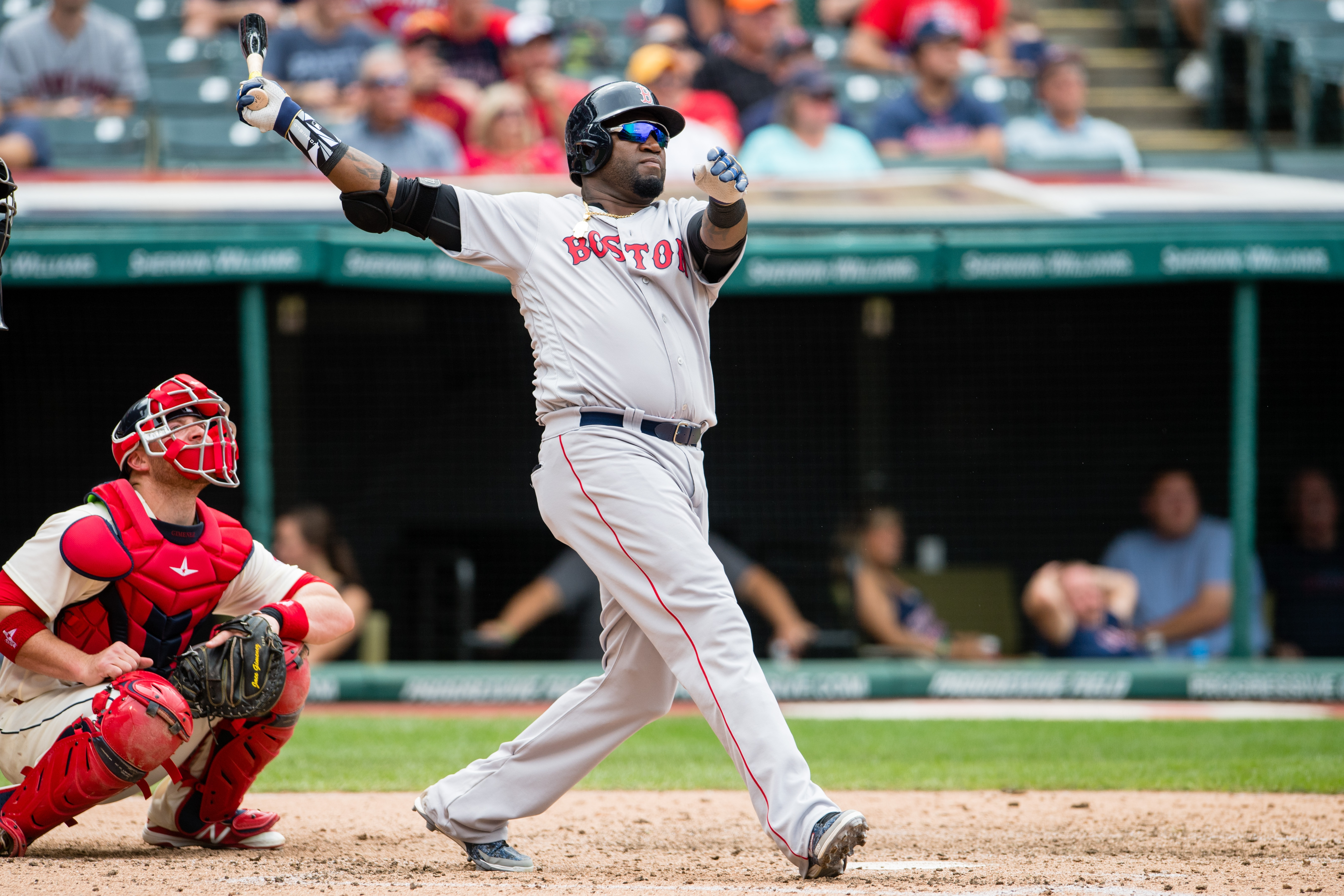 CLEVELAND, OH - AUGUST 15: David Ortiz #34 of the Boston Red Sox hits a two-run home run during the sixth inning against the Cleveland Indians at Progressive Field on August 15, 2016 in Cleveland, Ohio. (Photo by Jason Miller/Getty Images)