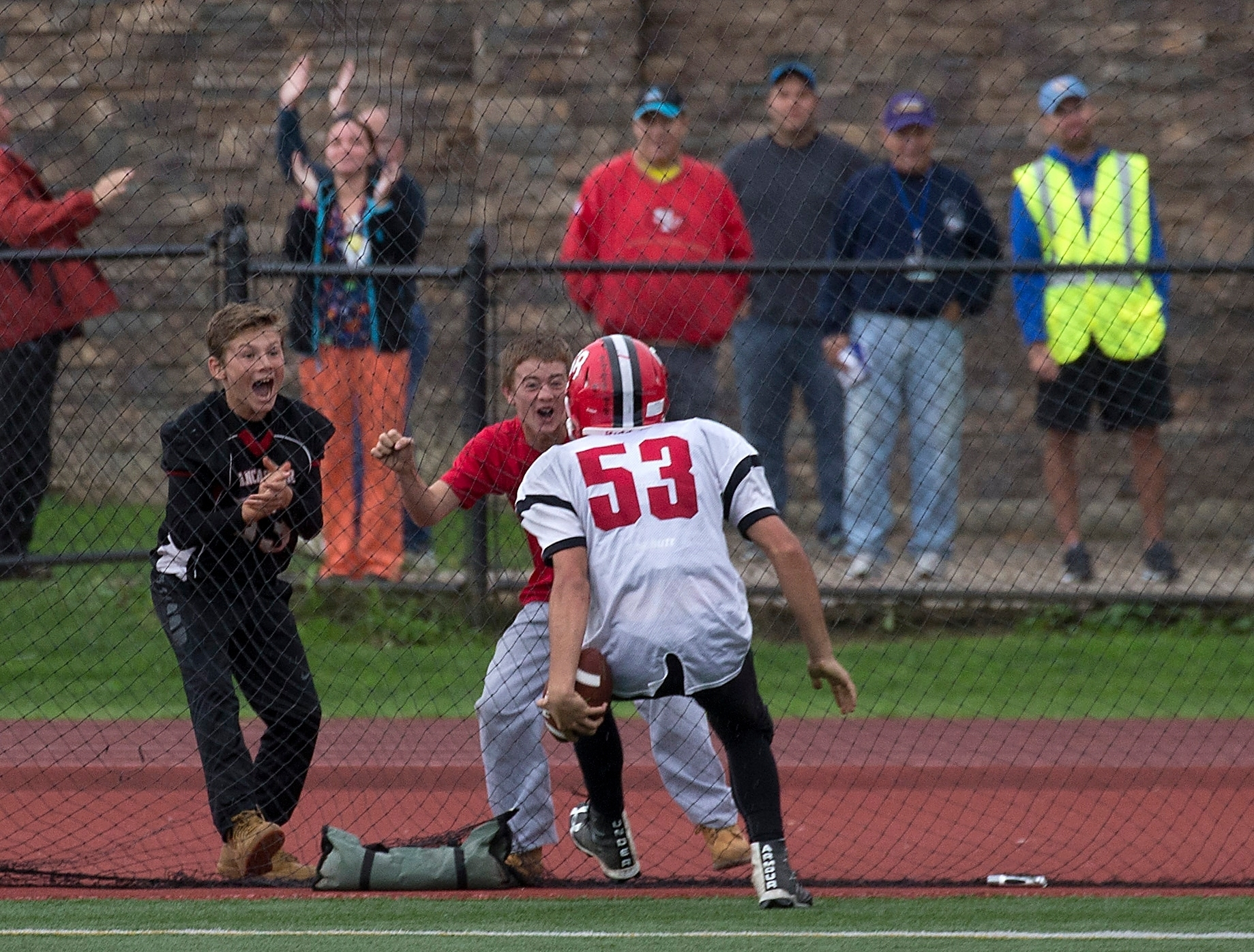 The fan reaction says it all as Lancaster's Jacob Michalski celebrates his late TD return of a blocked punt good for a victory over Orchard Park.