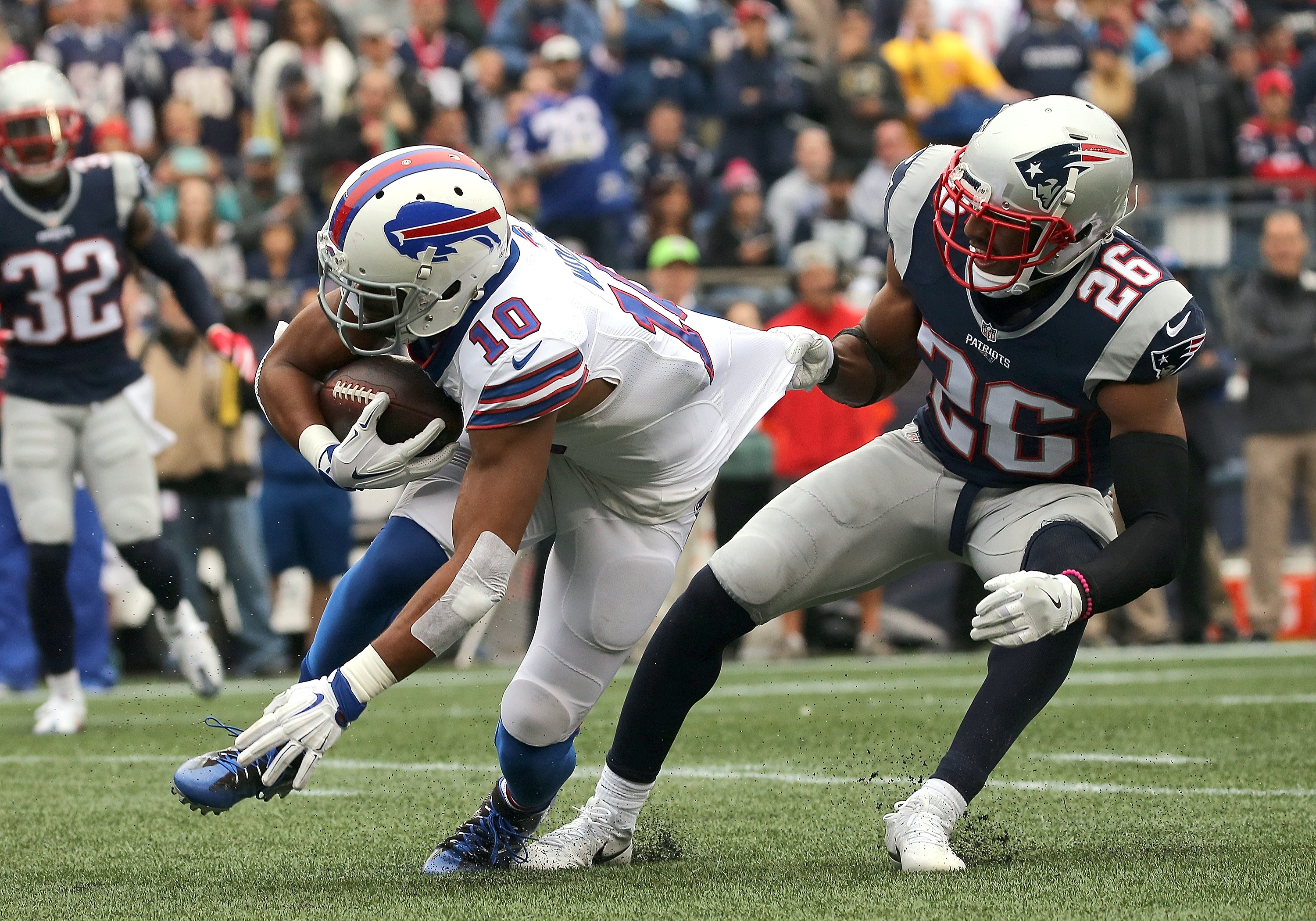 Robert Woods gains yards as Logan Ryan tries to defend.
