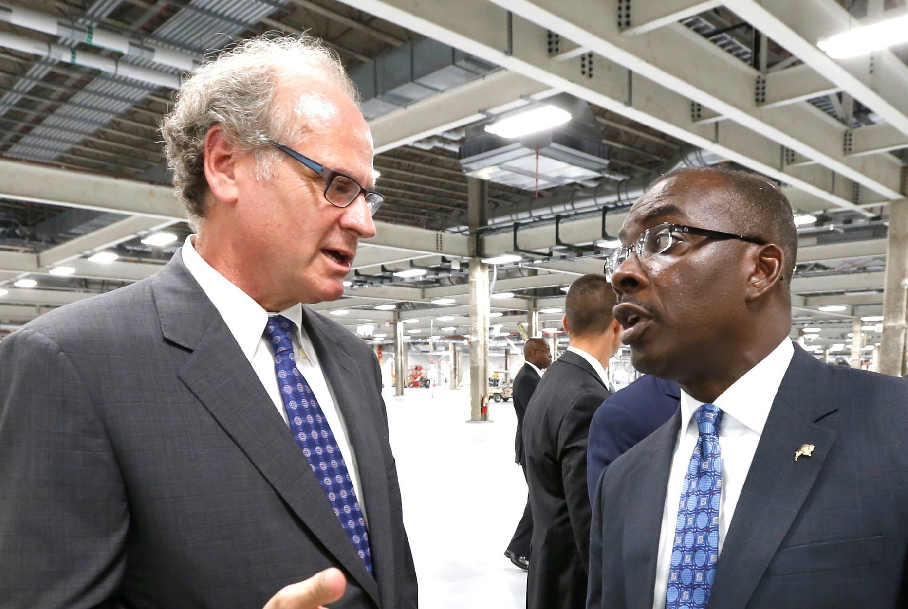 Empire State Development CEO Howard Zemsky and Buffalo Mayor Byron Brown speak during a tour of the SolarCity factory at RiverBend. (Robert Kirkham/Buffalo News)