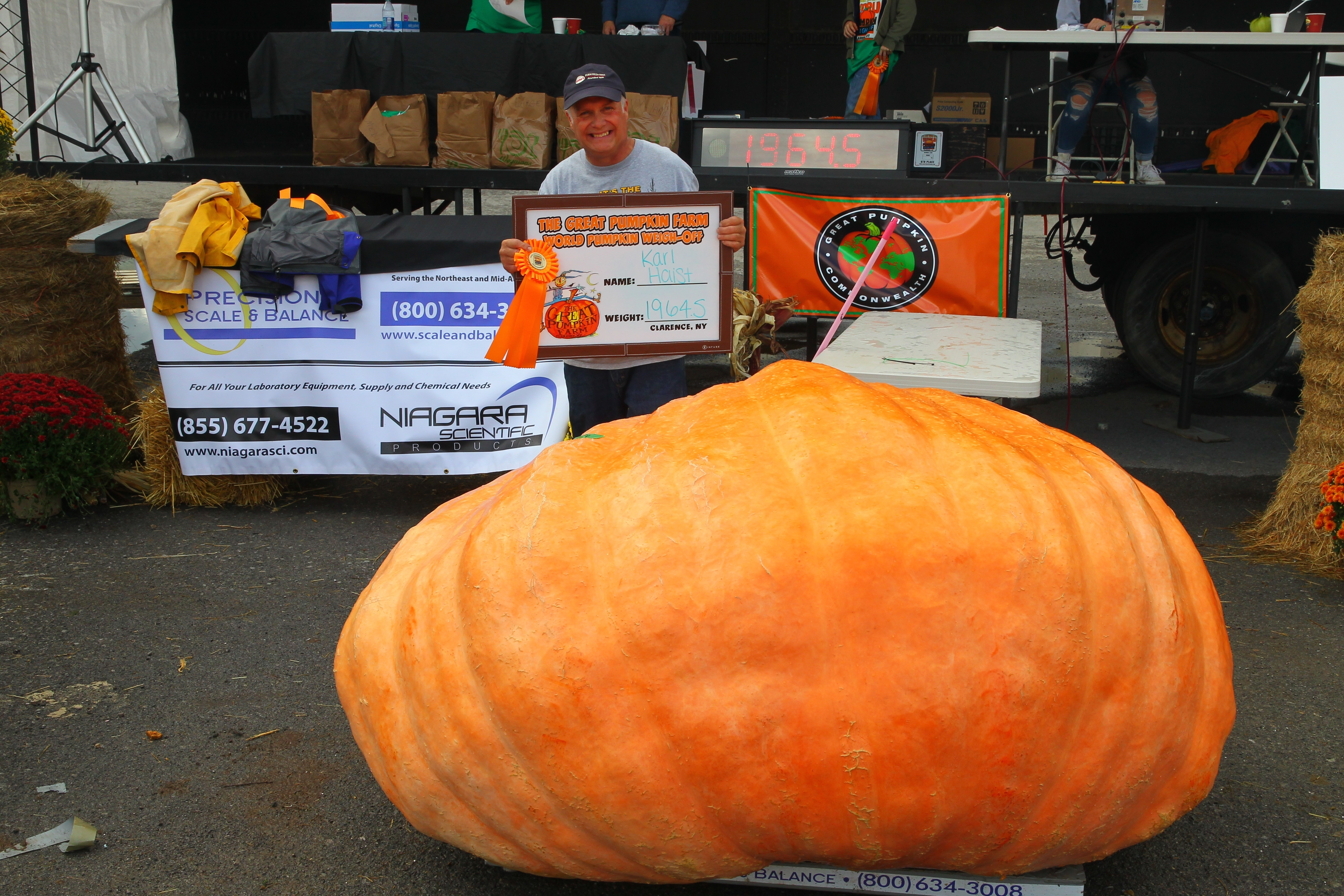 Karl Haist, of Clarence Center, and his pumpkin that weighed in at 1,964.5 pounds took him to a first place finish for the second year in a row at the 21st Annual Great Pumpkin Farm World Pumpkin Weigh-Off in Clarence on Sunday, Oct. 2, 2016. (John Hickey/Buffalo News)