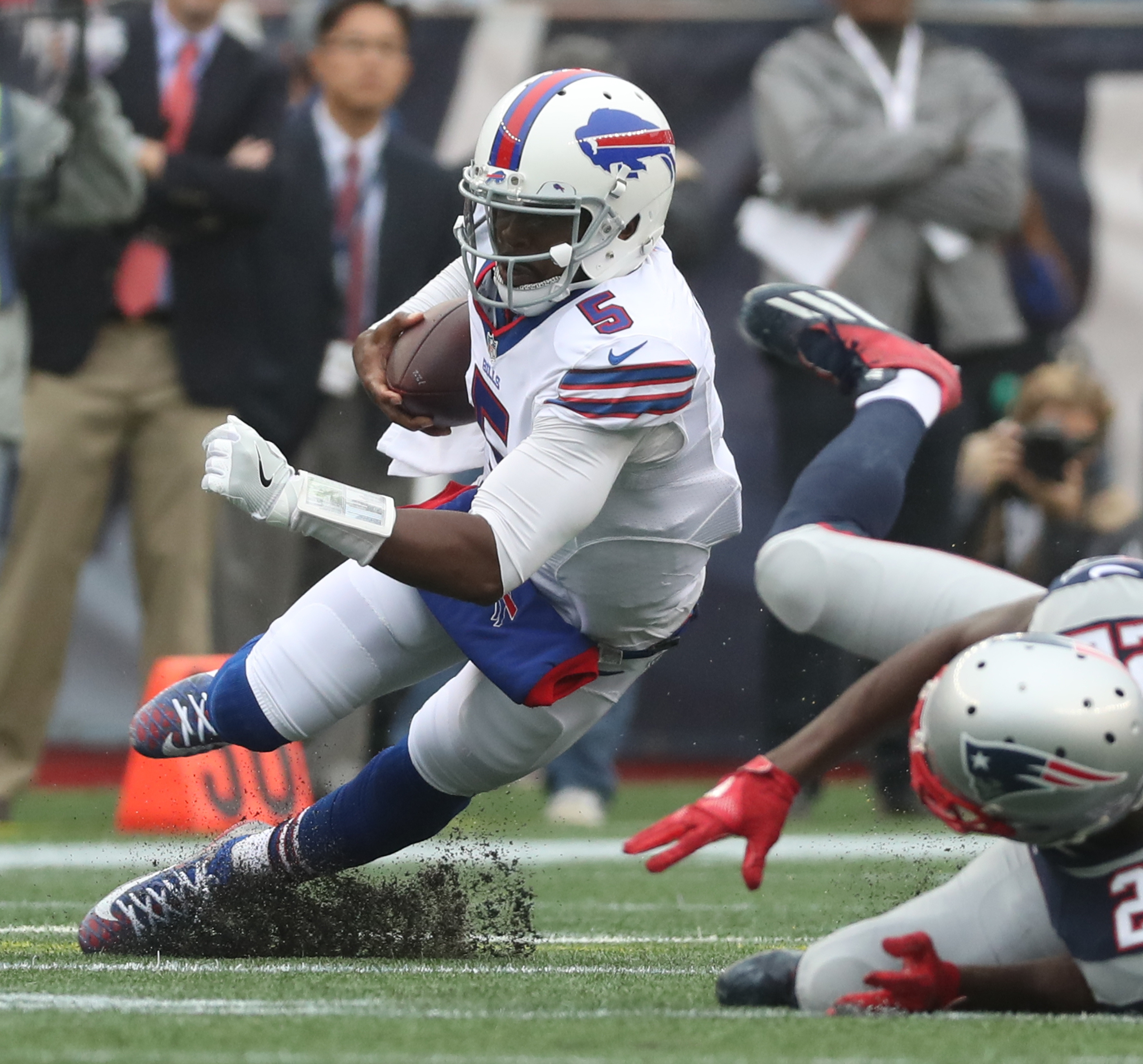 Buffalo Bills quarterback Tyrod Taylor (5) rushed for a first down against New England Patriots cornerback Justin Coleman (22) in the second quarter at Gillette Stadium in Foxborough, MA on Sunday, Oct. 2, 2016.  (James P. McCoy/ Buffalo News)