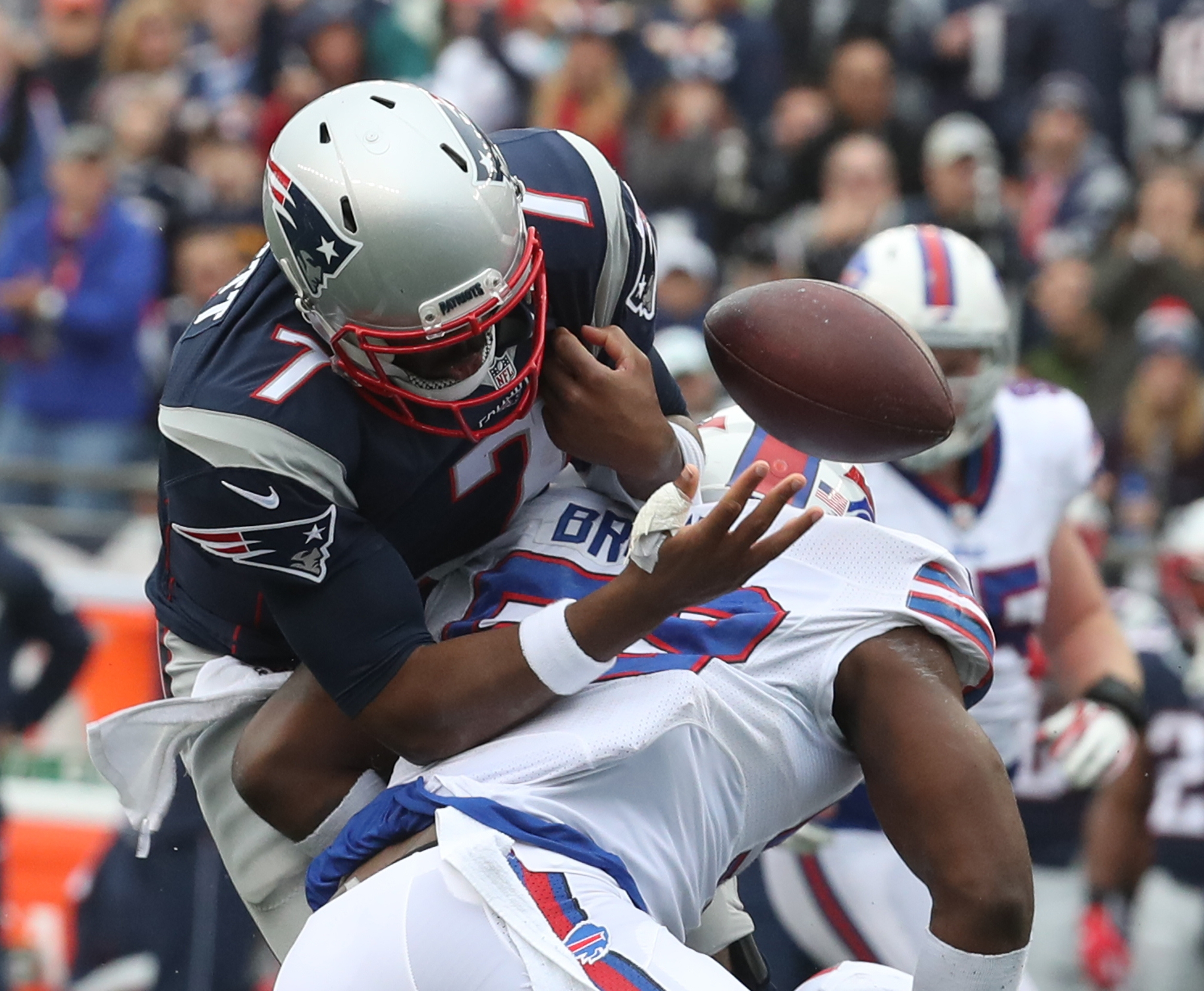 Buffalo Bills inside linebacker Zach Brown forces a fumble by New England Patriots quarterback Jacoby Brissett (7) in the second quarter.