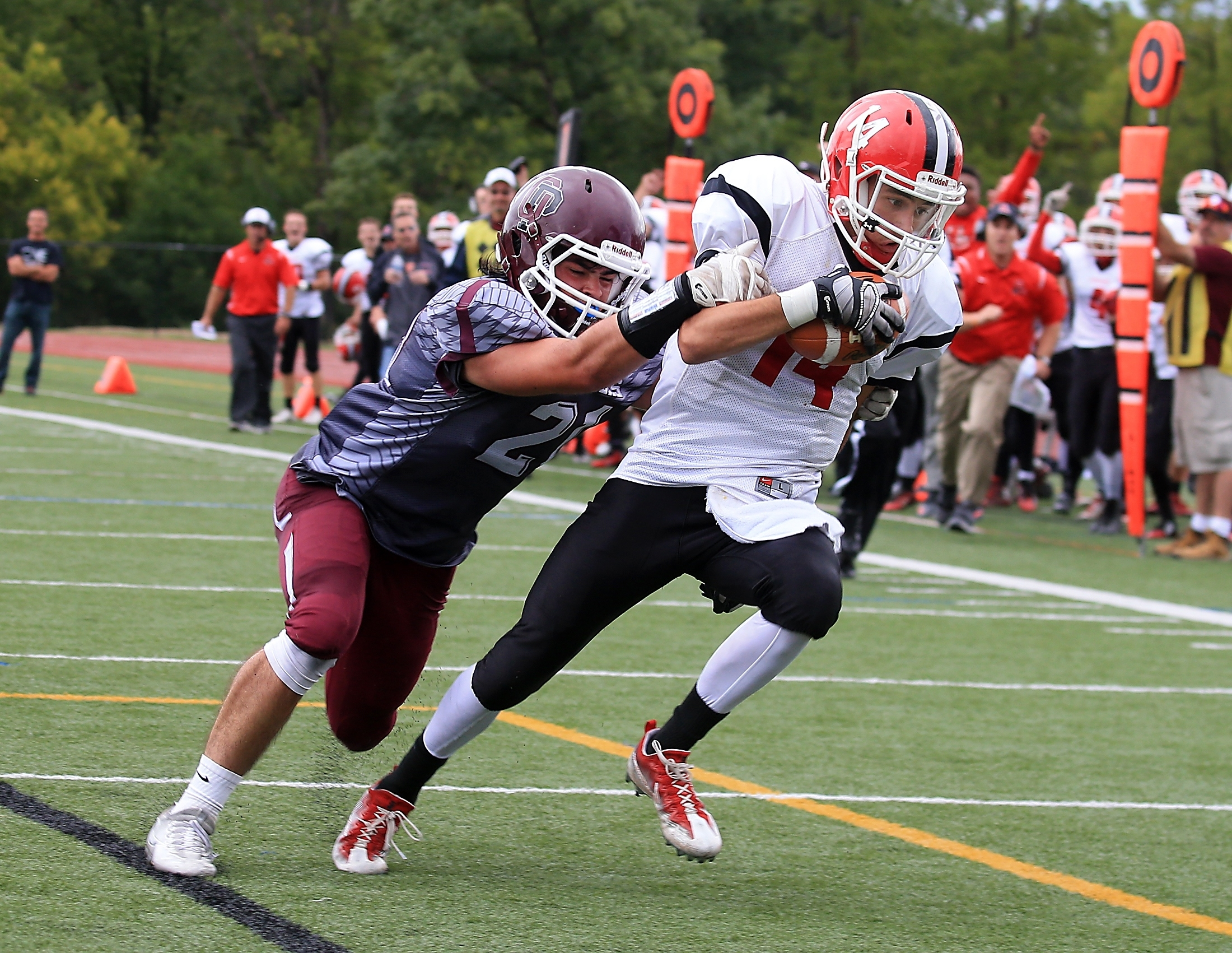 Orchard Park's Ethan Wood (21) can't keep Lancaster's Max Giordano (14) from scoring in Saturday's Legends victory.
