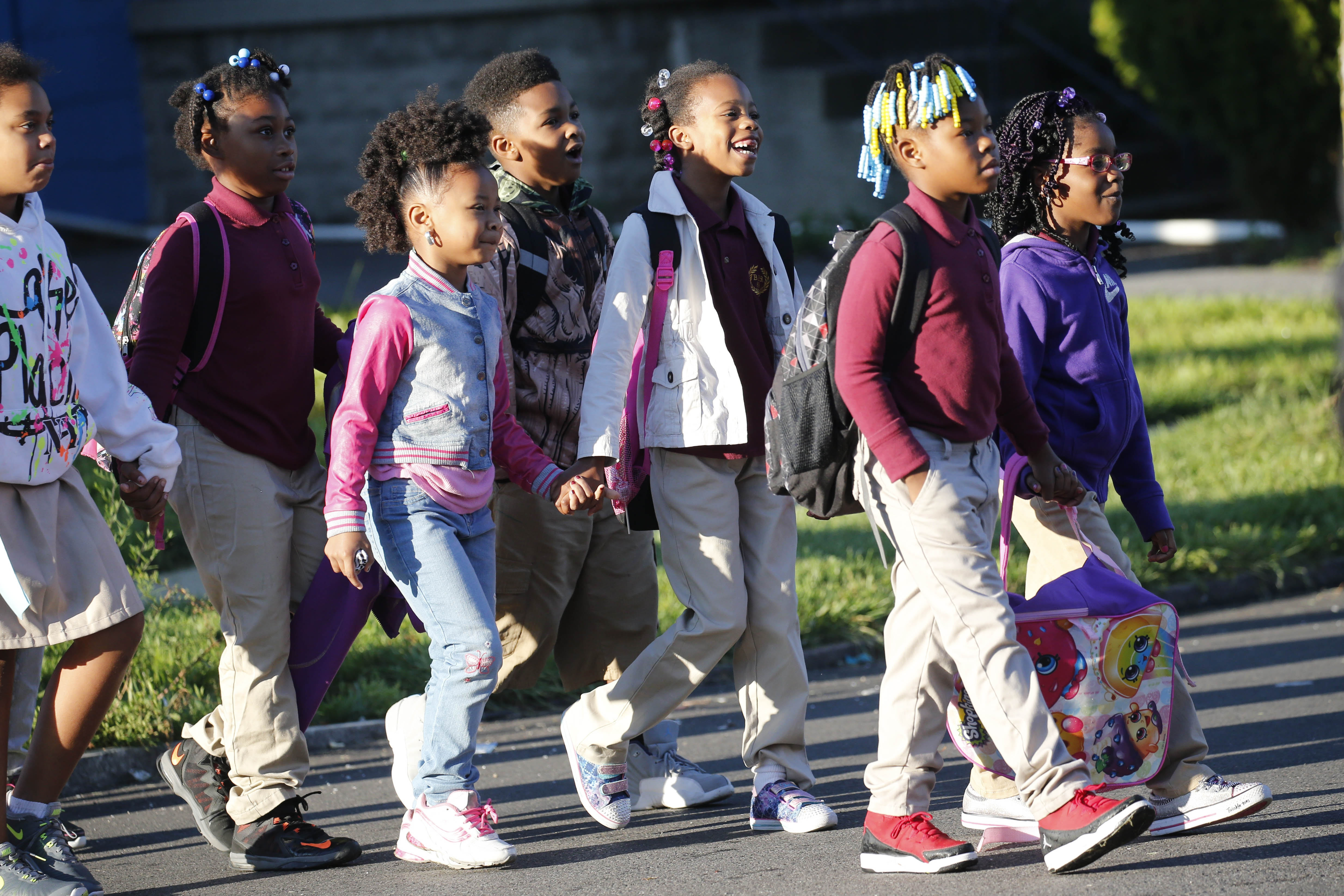 A group of students and faculty from Highgate Heights Elementary School walks down Orleans Street on their way to school as part of National Walk to School day, Wednesday, Oct. 5, 2016.  (Derek Gee/Buffalo News)