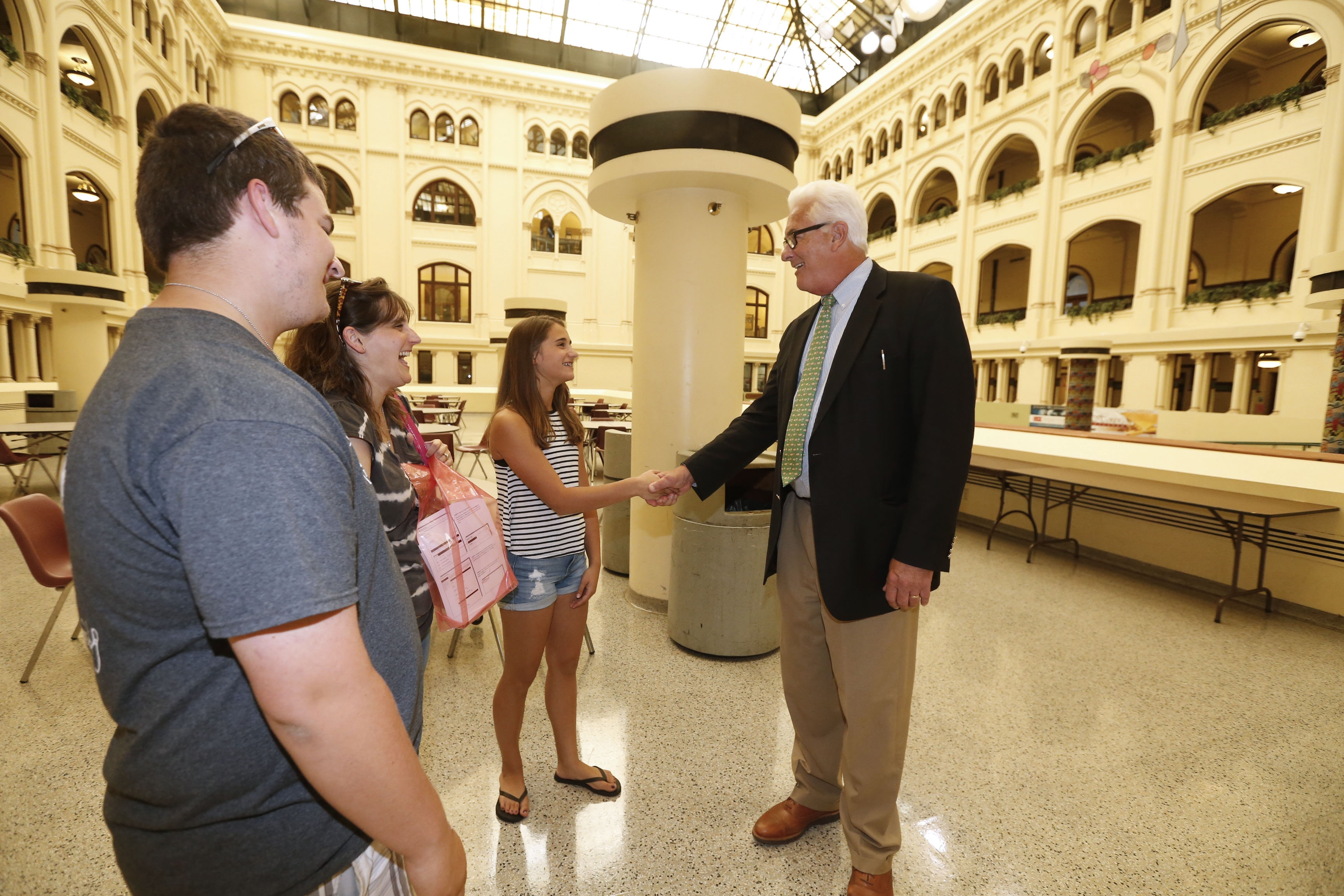 Erie Community College President Jack Quinn greets students touring the campus in August. Declining enrollments require ECC and other community colleges to re-engineer their operations.
