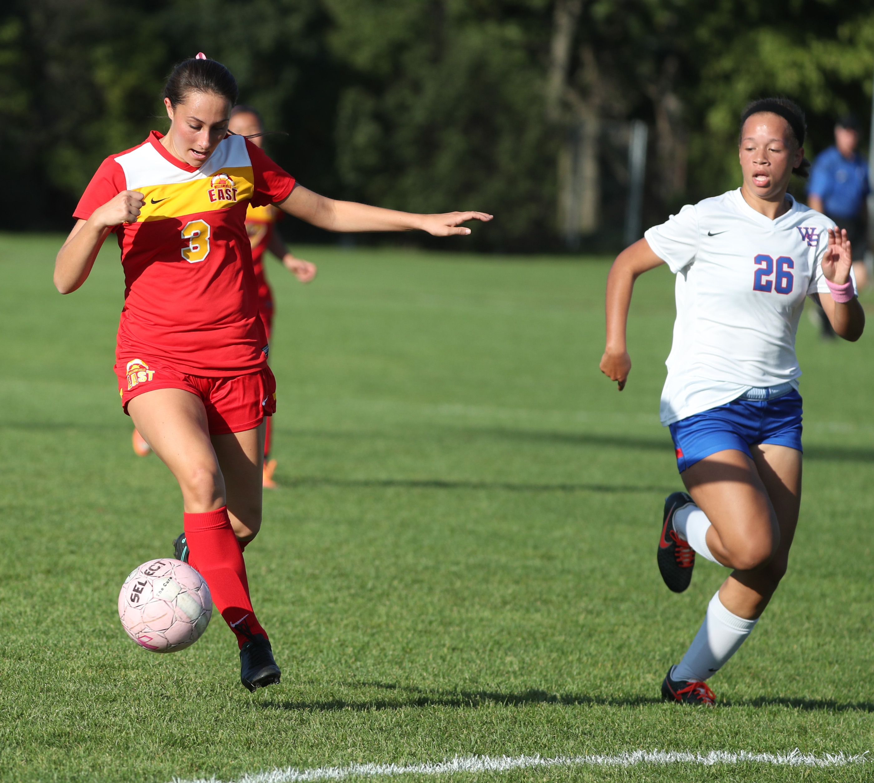 Williamsville South's Ashlea Green tries to head off Williamsville East's Marissa Birzon in Wednesday's game. Birzon scored four goals in East's 6-1 victory.