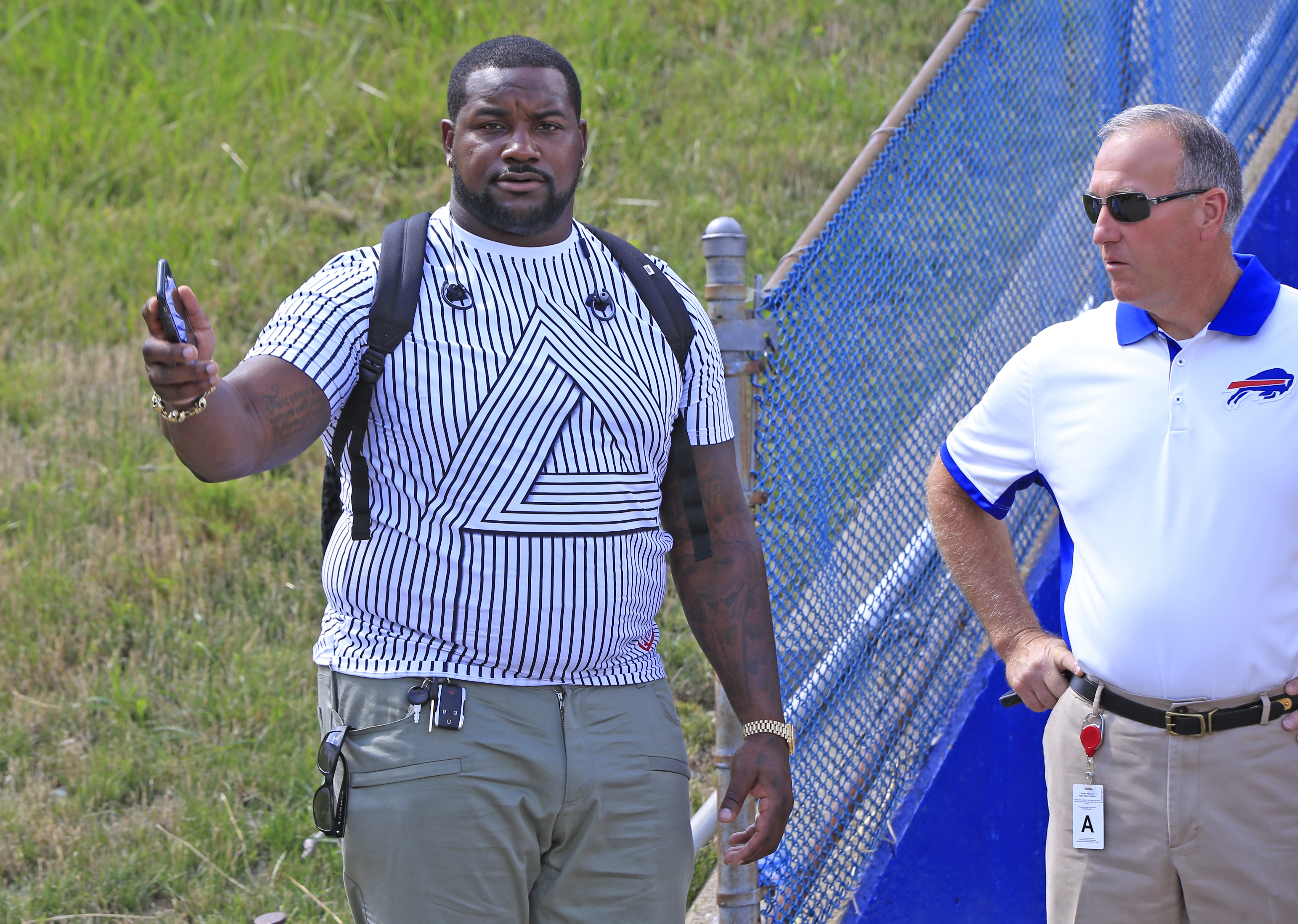 Buffalo Bills Marcell Dareus talks with Eddie Cotter, Buffalo Bills security prior to leaving the stadium before playing the New York Giants at New Era Field on Saturday, Aug. 20, 2016. (Harry Scull Jr./Buffalo News)