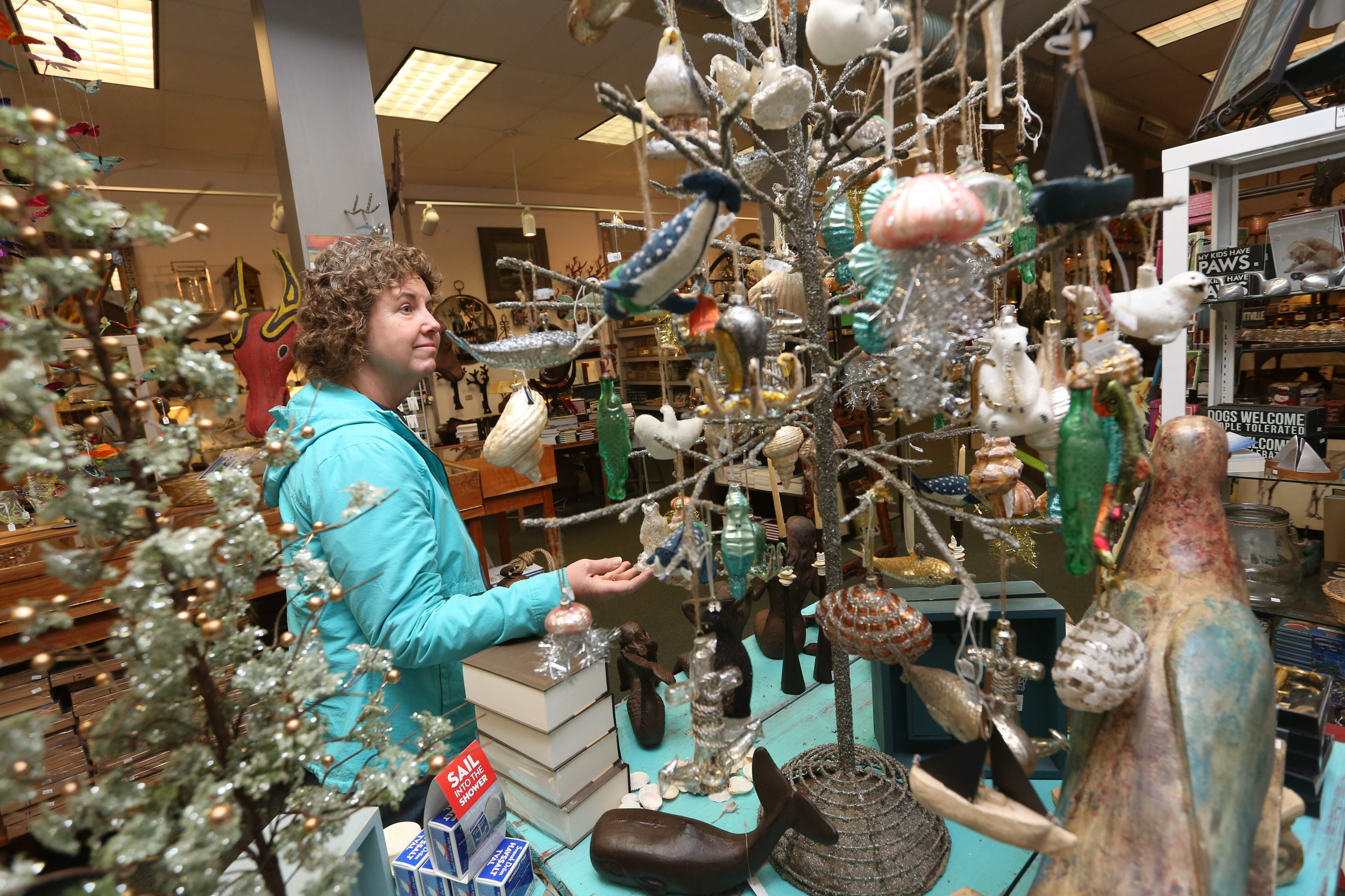 Ellicottville will hold its popular fall festival on Columbus weekend. Kazoo II at 21 Washington St. is an eclectic gift shop. Maryann DeGennaro, of Wheatfield,  looks at some ornamentsThursday, Oct. 1, 2015.  (Sharon Cantillon/Buffalo News)