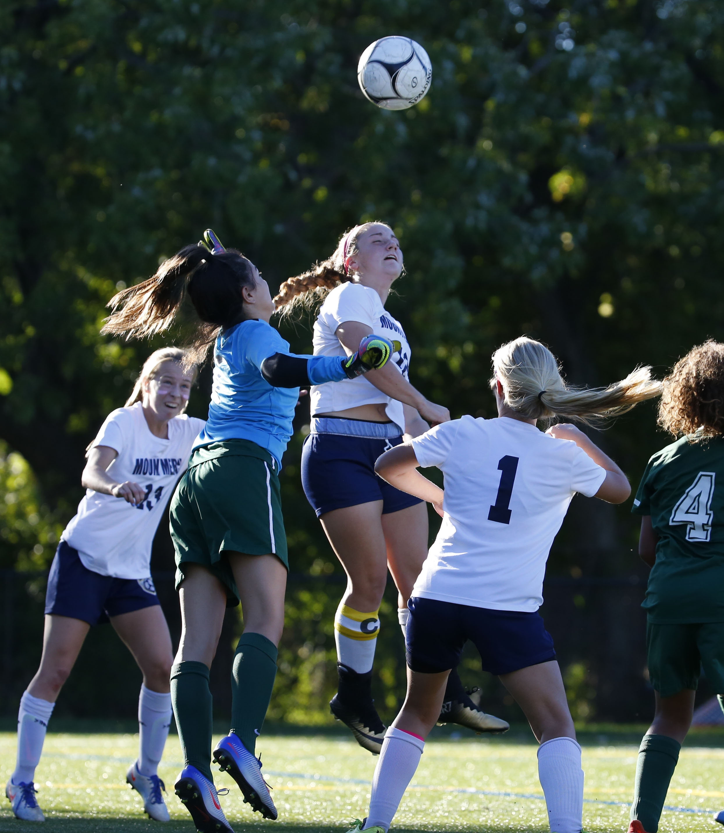 Mount Mercy's Alyssa Siracuse heads a ball toward the Nichols goal during first half action Friday at Mulroy Park.