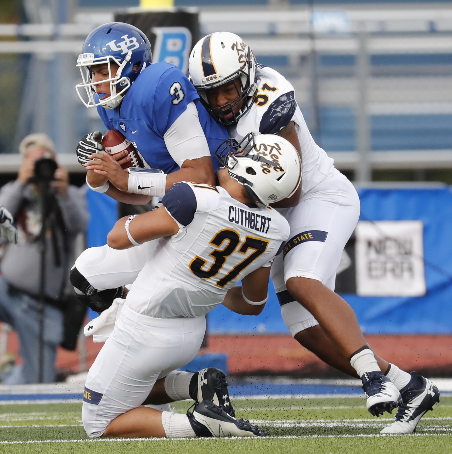 UB quarterback Tyree Jackson is taken down for a sack by Kent State's Nick Cuthbert and Terence Waugh. Jackson completed 20 of 39 passes for 250 yards and one touchdown with no interceptions.
