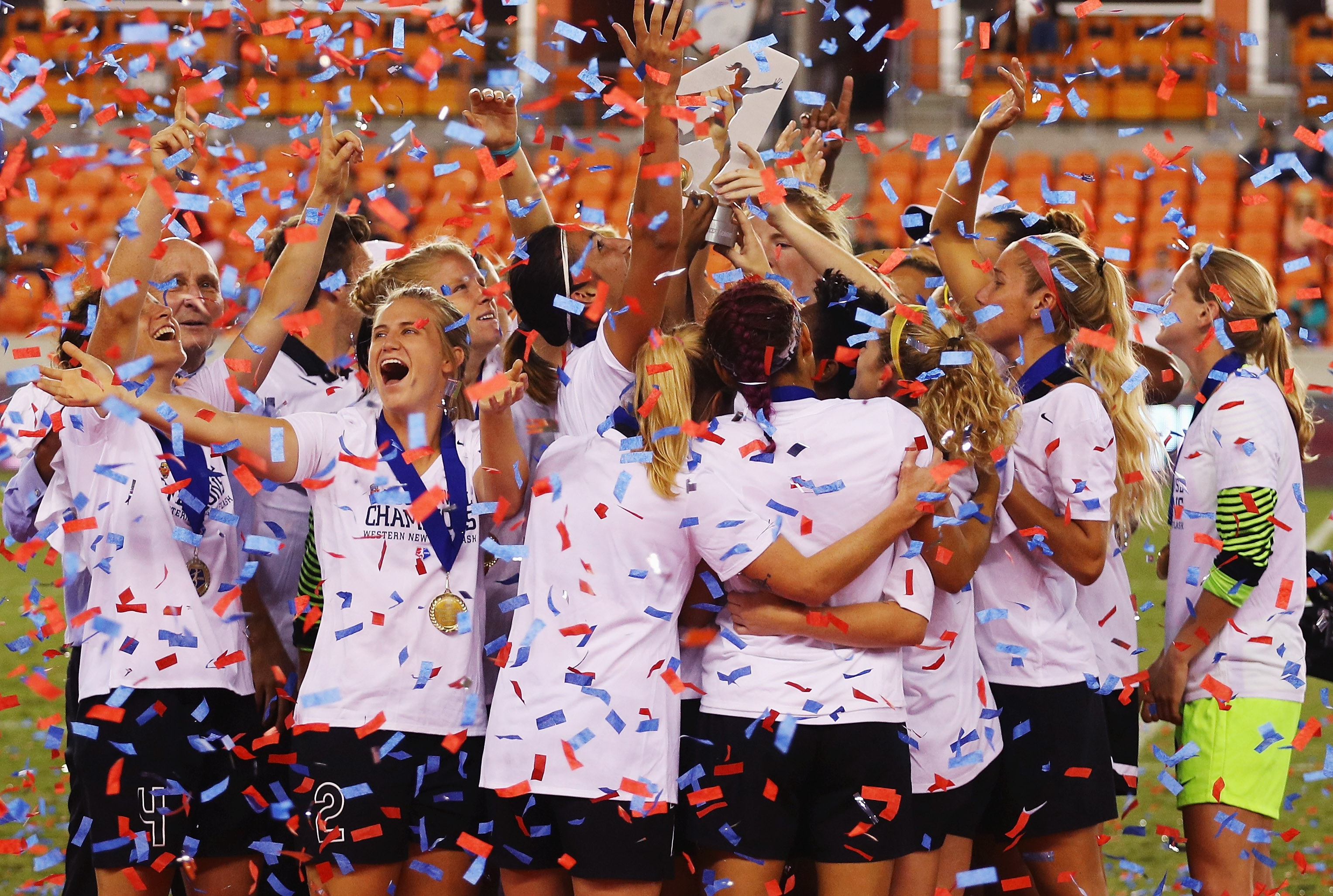 Members of the Western New York Flash celebrate after defeating the Washington Spirit in a shootout to win the 2016 NWSL Championship at BBVA Compass Stadium.