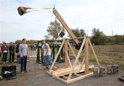 The Great Pumpkin Farm holds its 11th annual Pumpkin Catapult Contest, Sunday, Oct. 16, 2016. Technology classes from 15 schools competed. They constructed their catapult machines and competed in different categories such as hitting a target and longest distance. Five teams compete at a time. Genesee Valley High School takes a shot. (Sharon Cantillon/Buffalo News)