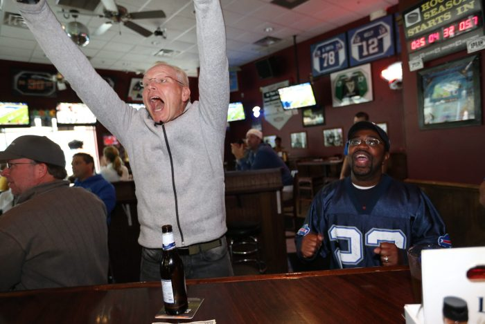 Fans cheer the home team on at Amherst Pizza & Ale House in Getzville. (Sharon Cantillon/Buffalo News file photo)
