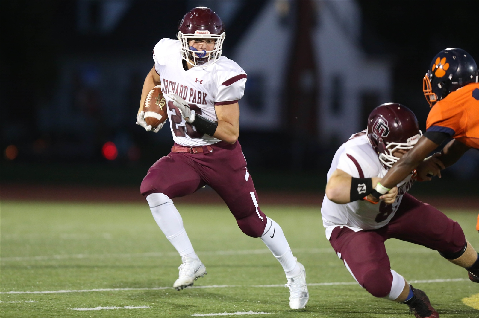 Josh Dahl and the defending Class AA champion Orchard Park Quakers. (Dave DeLuca/Special to The News)