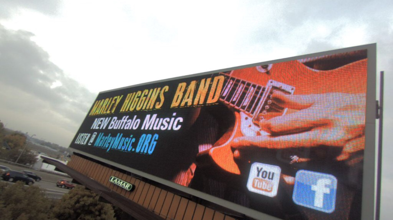 A billboard on the southbound 33 promotes Buffalo independent outfit the Marley Higgins Band.
