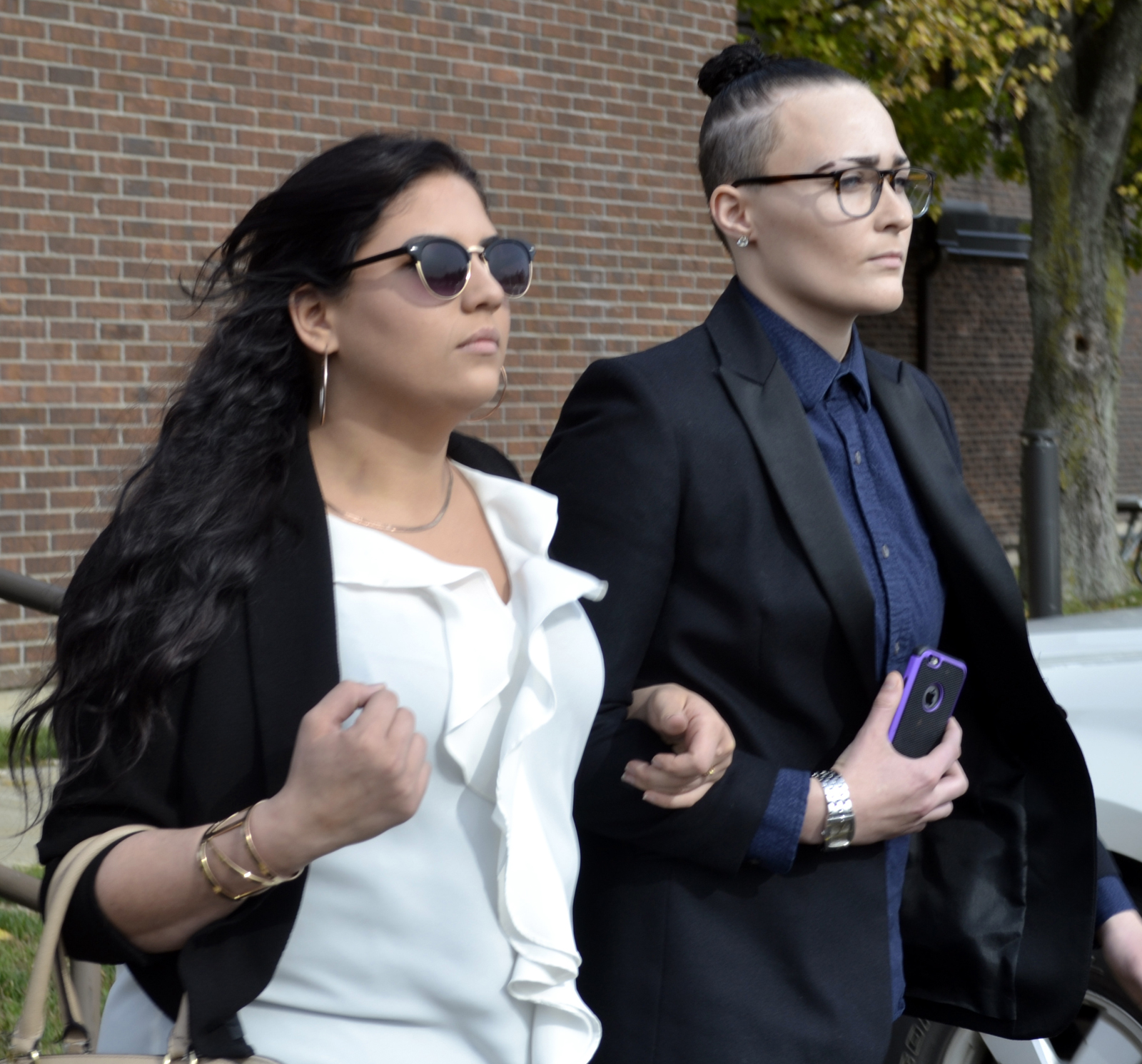 Carly Marrs, on left,  appeared in Wheatfield Town Court on Wednesday, Oct. 26, 2016 and pleaded not guilty to charges related to a double-fatal crash. Marrs was charged with reckless driving, imprudent speed and unlawful possession of marijuana after her car hit pedestrians on  Shawnee Road shortly after midnight Aug. 20, 2016. (Photo by Larry Kensinger)