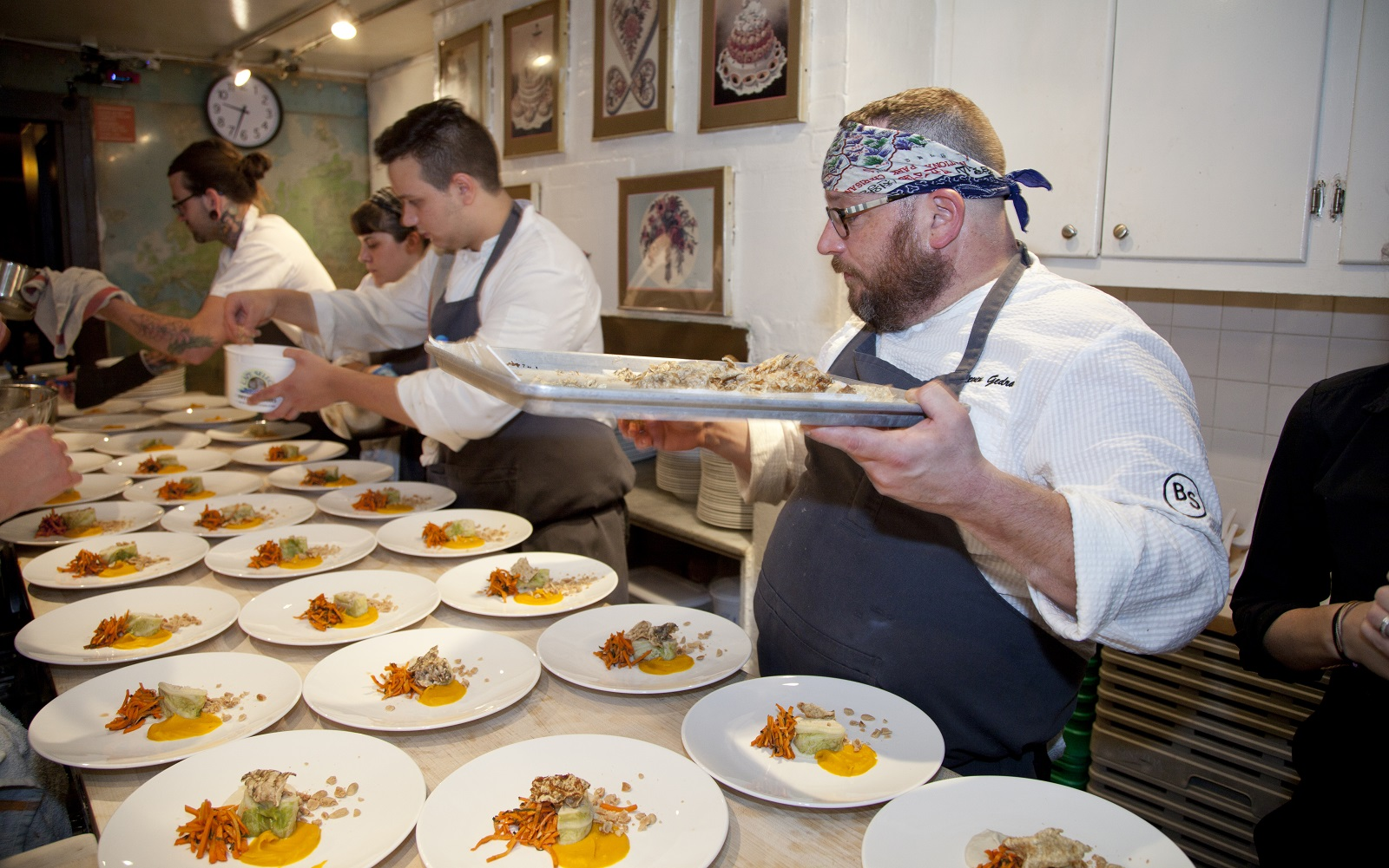 Chef Steve Gedra, right, helps his team plate food at the James Beard House. (Rina Oh/James Beard House)