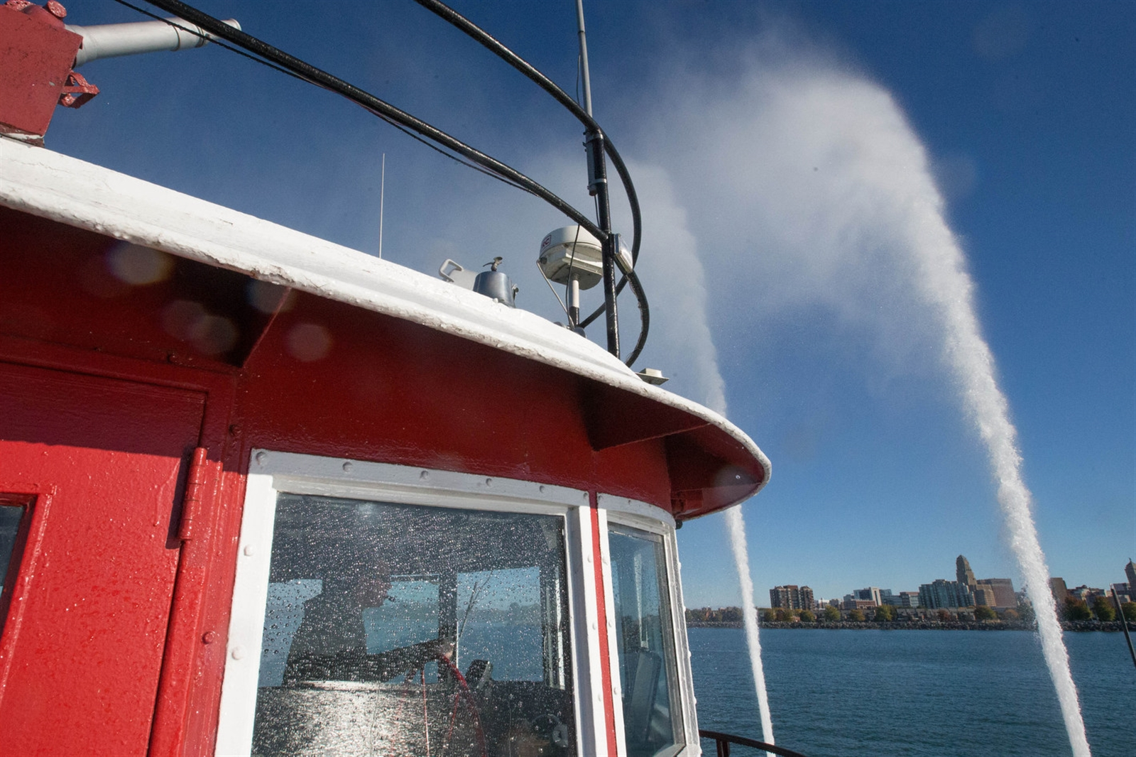 The sprays of water from the water cannons of the Edward M. Cotter are one of the most spectacular sights of the Buffalo waterfront. (Derek Gee/Buffalo News)