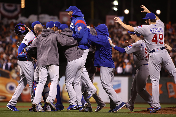 The party is on as the Cubs celebrate their division series clincher Tuesday night in San Francisco (Getty Images).