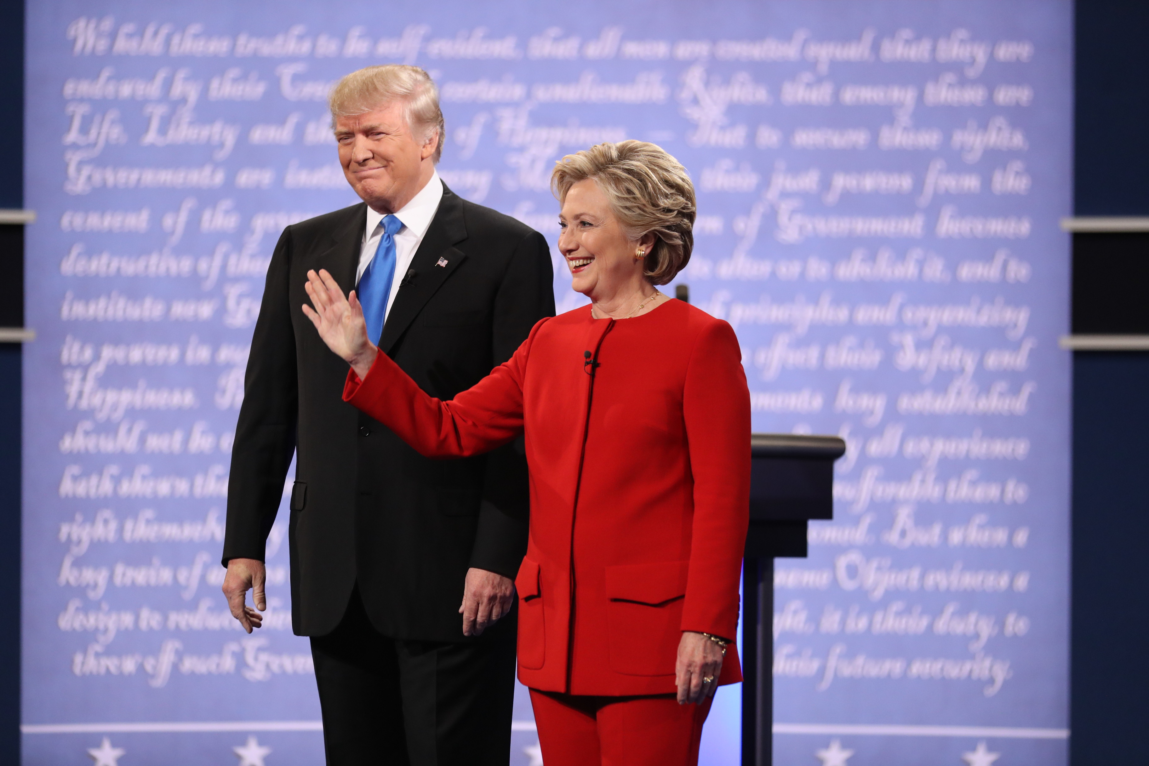 Hillary Clinton and Donald Trump take the stage for their first presidential debate at Hofstra University in Hempstead, N.Y., on Sept. 26. The FBI announced Oct. 28 that it would conduct a new investigation into Clinton's use of a private email server. (Damon Winter/New York Times)