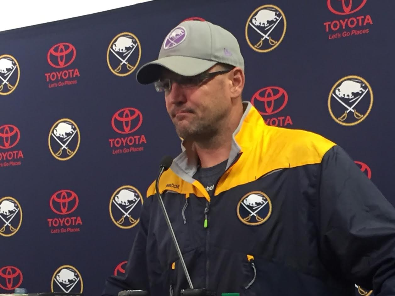 A somber Dan Bylsma meets reporters after Jack Eichel was injured in practice Wednesday (Mike Harrington/Buffalo News).