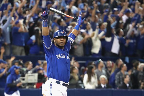 Edwin Encarnacion celebrates his walkoff home run in the 11th inning Tuesday night (Getty Images).