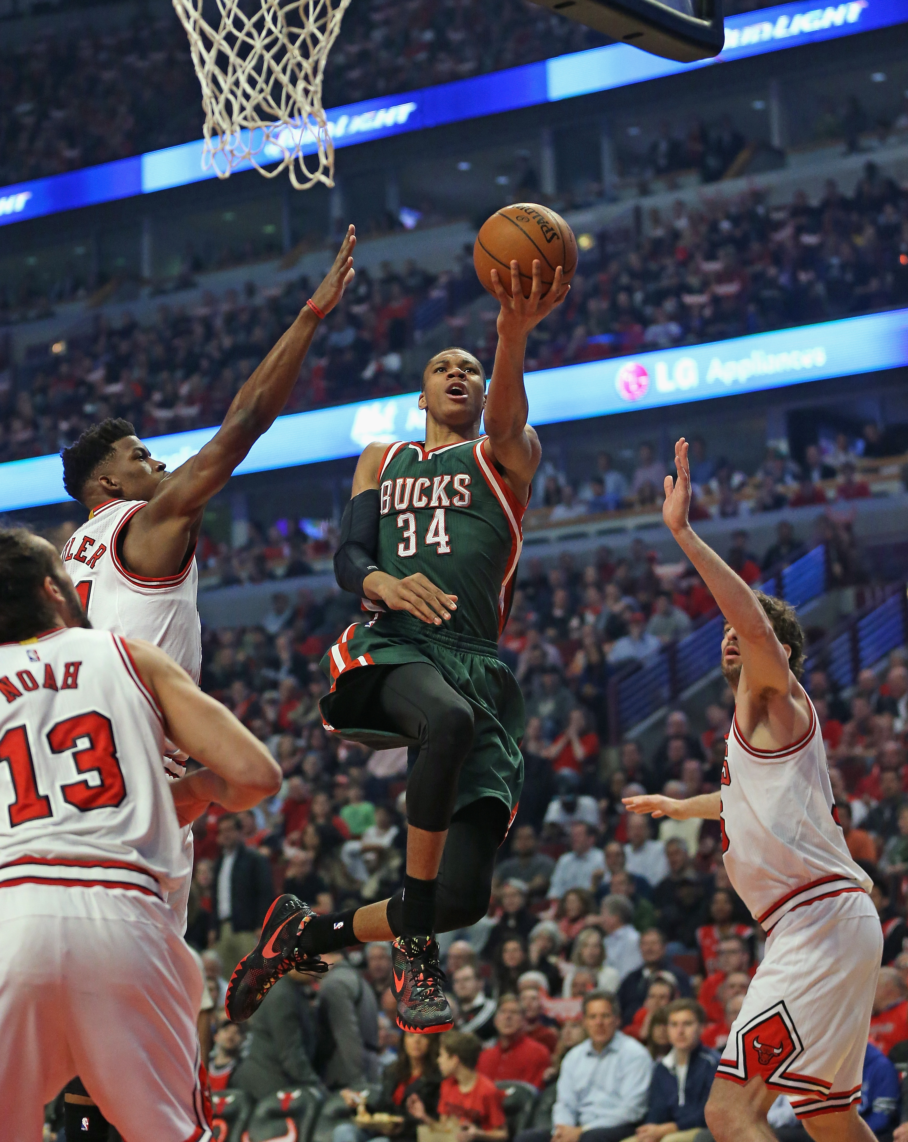 CHICAGO, IL - APRIL 20: Giannis Antetokounmpo #34 of the Milwaukee Bucks goes up for a shot over (L-R) Joakoim Noah #13, Jimmy Buter #21 and Pau Gasol #16 of the Chicago Bulls during the first round of the 2015 NBA Playoffs at the United Center on April 20, 2015 in Chicago, Illinois. NOTE TO USER: User expressly acknowledges and agress that, by downloading and or using the photograph, User is consenting to the terms and conditions of the Getty Images License Agreement. (Photo by Jonathan Daniel/Getty Images)