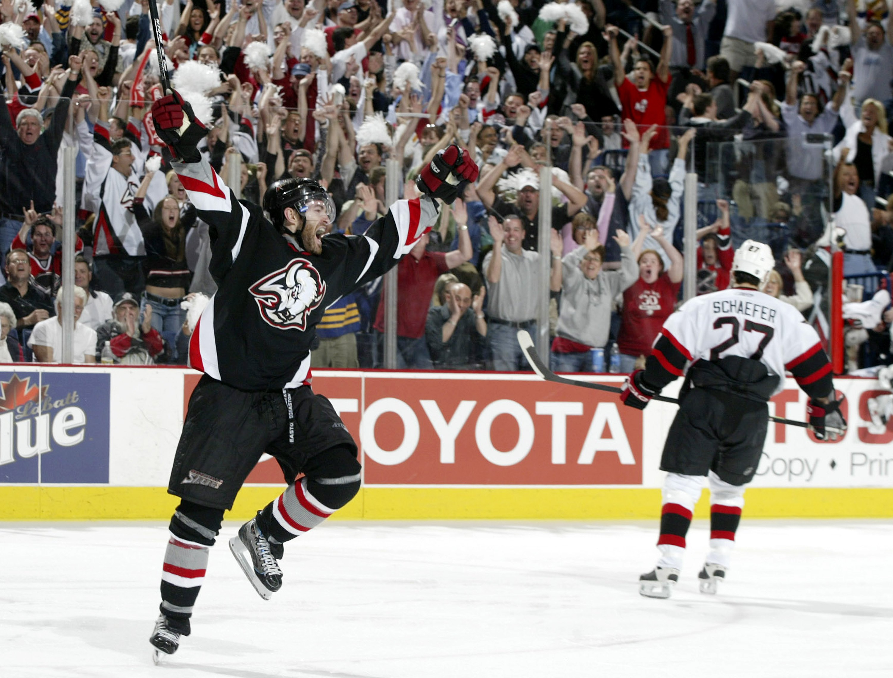 J.P. Dumont #17 of the Buffalo Sabres celebrates scoring the game-winning goal at 14:55 of the first overtime period to defeat the Ottawa Senators 3-2 in game three of the Eastern Conference Semifinals on May 10, 2006 at HSBC Arena in Buffalo, New York. (Photo by Rick Stewart/Getty Images)