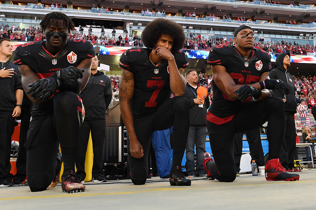 49ers quarterback Colin Kaepernick, center, said on Wednesday he was disappointed in the criticism leveled at him by Supreme Court Justice Ruth Bader Ginsburg. (Getty Images)