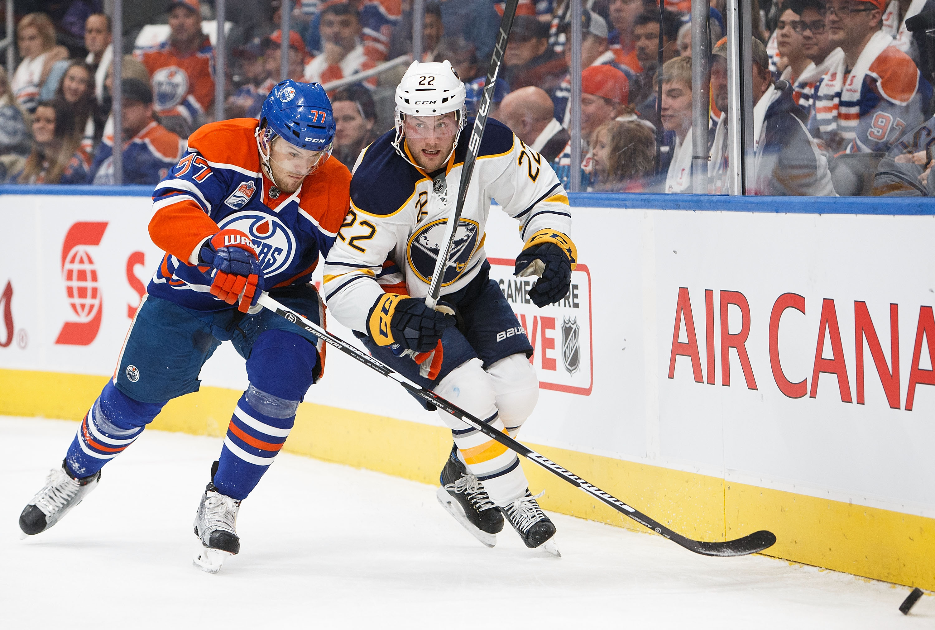 Oscar Klefbom of the Edmonton Oilers battles Johan Larsson (22) of the Buffalo Sabres. (Getty Images)