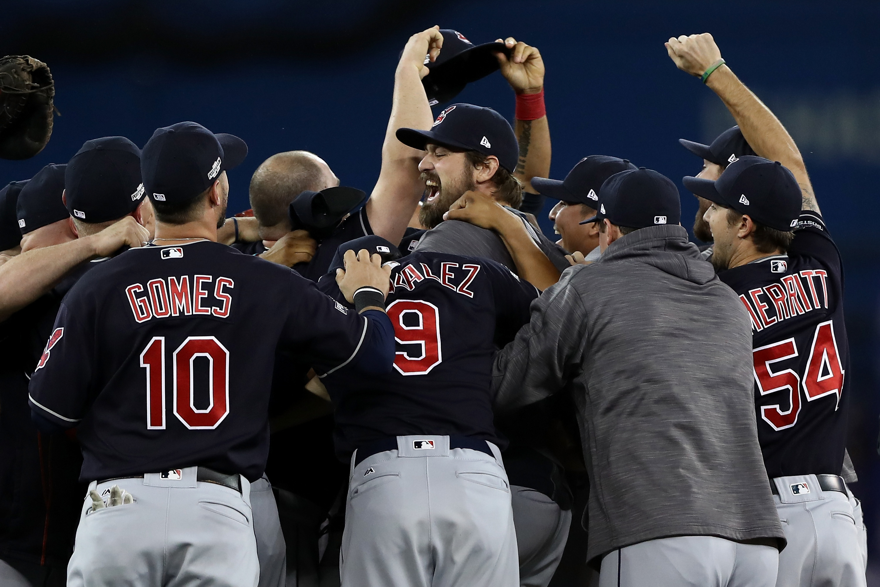 The Cleveland Indians celebrate after defeating the Toronto Blue Jays Wednesday to win the American League Championship. (Getty Images)