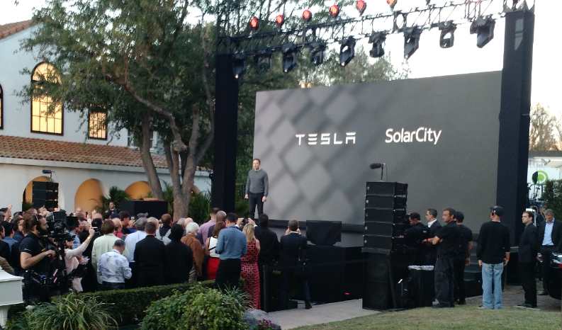 Elon Musk, Tesla's CEO and SolarCity's chairman, unveiled plans Friday night for a solar roof that can be customized for individual homes and combined with higher-capacity Tesla batteries that can store twice as much energy as the current model. (David Robinson/Buffalo News)