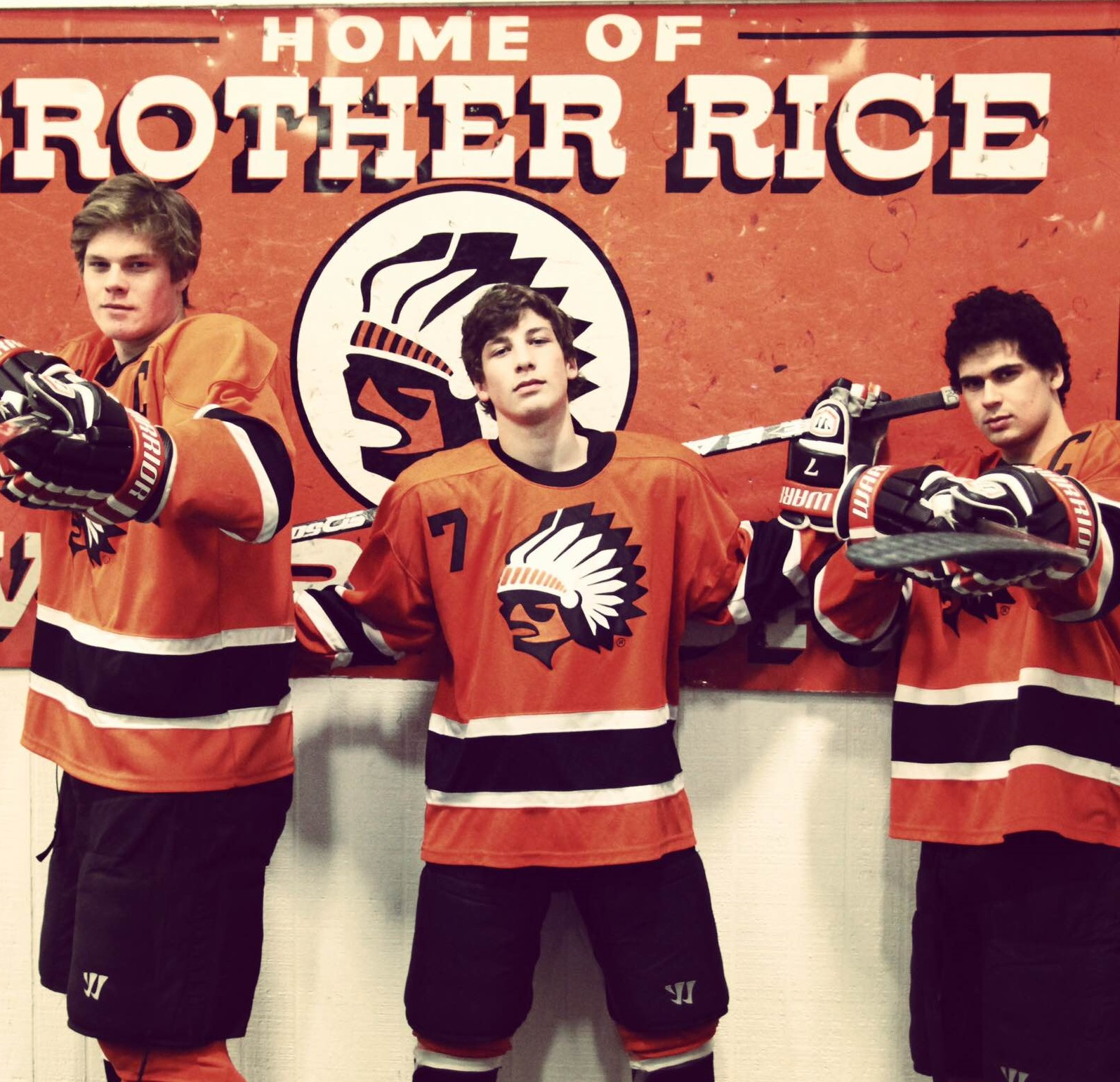 Brother Rice High School hockey star Russell Cicerone poses in the middle. (via Cicerones)