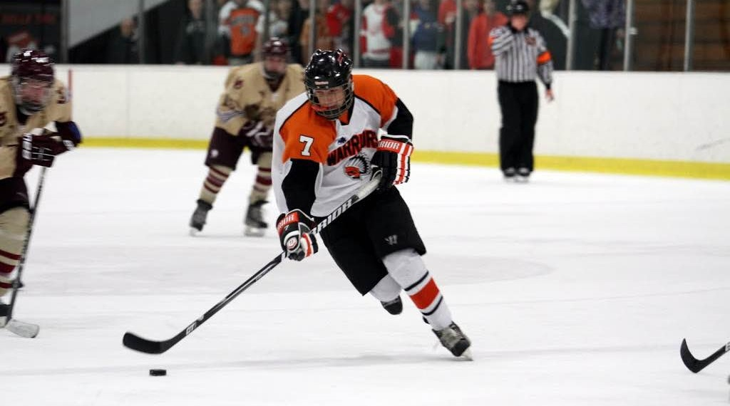 Brother Rice High School center Russell Cicerone flies down the middle of the ice. (via Cicerones)