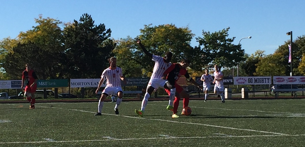 Bass Sarr, in white, vies for the ball against Plattsburgh during the Bengals' 2-1 win. (Ben Tsujimoto/Buffalo News)