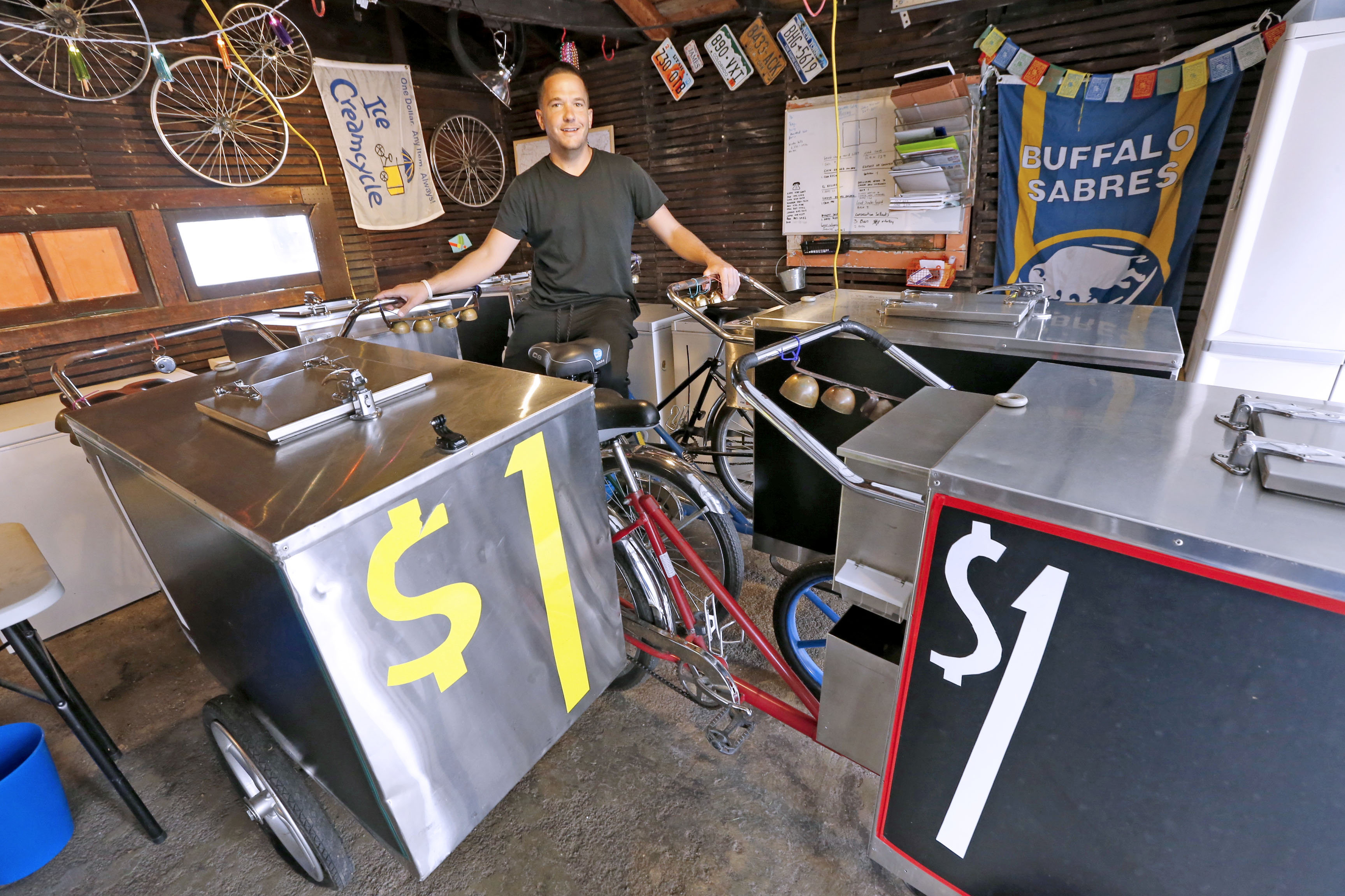 The Ice Creamcycle Dude, James Karagiannis, is wrapping up the season.  He will continue selling through October,  but then he's off to India until April.  (Robert Kirkham/Buffalo News)