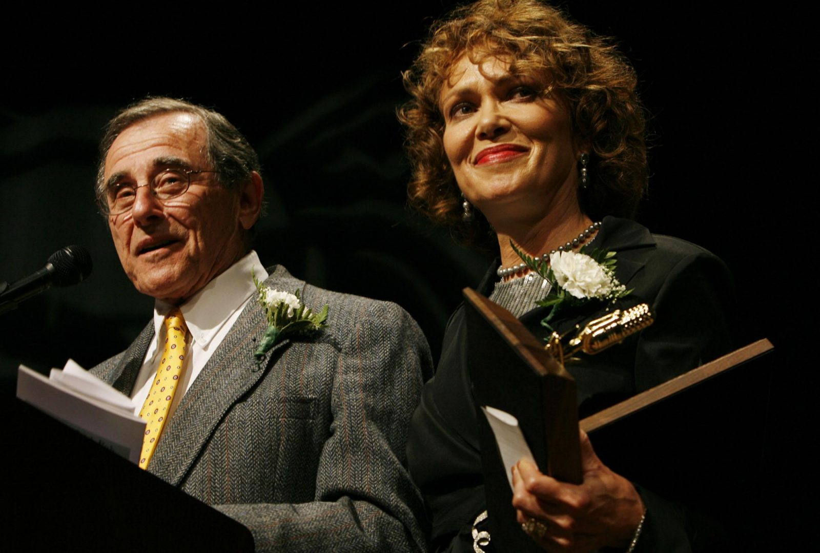 Irv Weinstein, here in 2007 inducing longtime colleague Susan Banks into the Buffalo Broadcasters Hall of Fame. (Harry Scull Jr./Buffalo News)