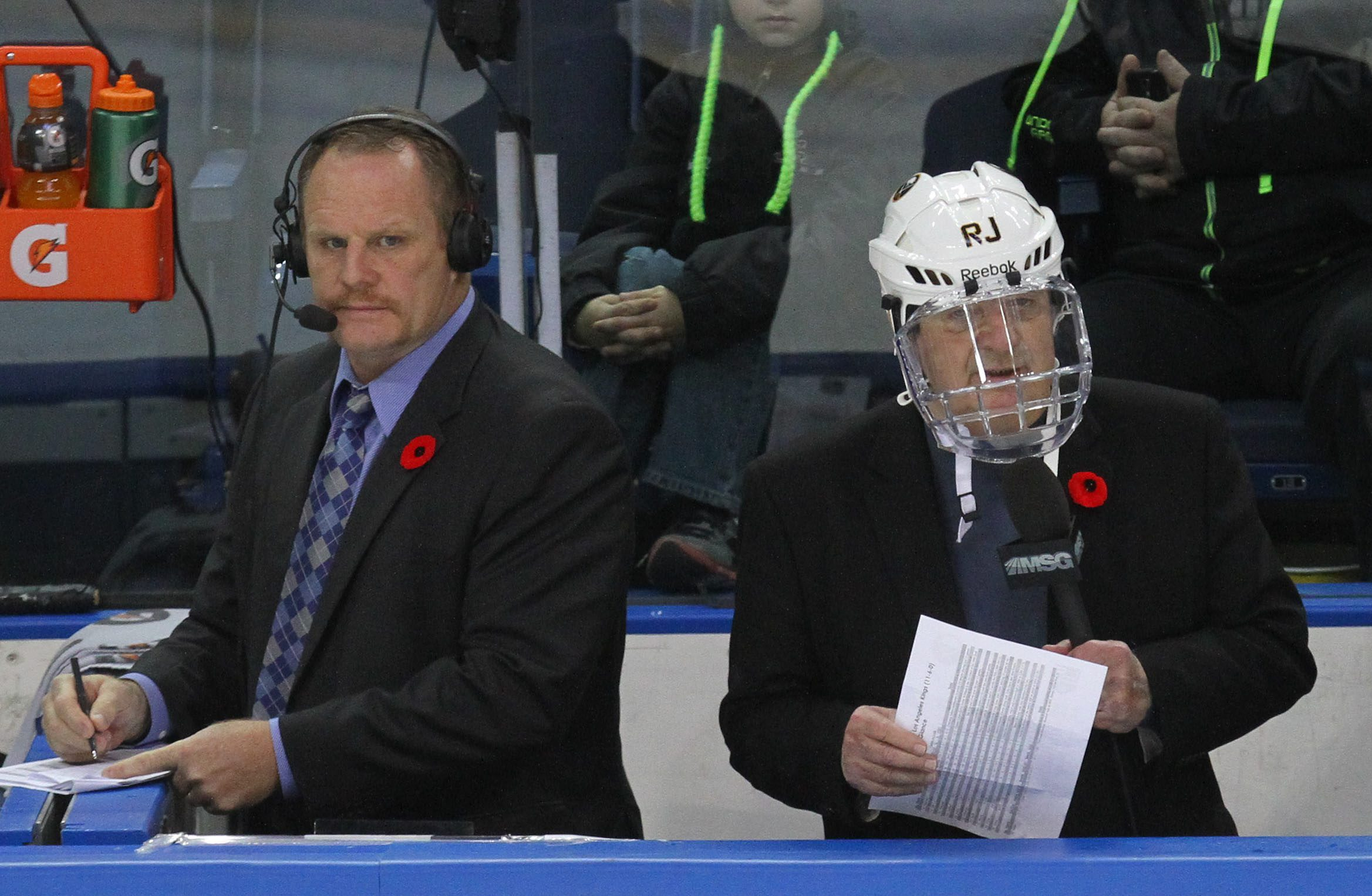 Rick Jeanneret and Rob Ray call the first period from between the benches in 2013. (Mark Mulville/News file photo)