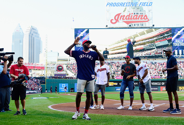 LeBron James and Cavs teammates pump up the crowd prior to Game Two of the division series (Getty Images).