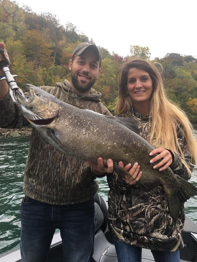 Liz Pratt caught this Devil's Hole salmon this week with Capt. Chris Cinelli. Liz's boyfriend Ryan Van Lew is holding the fish. It was her first salmon ever!
