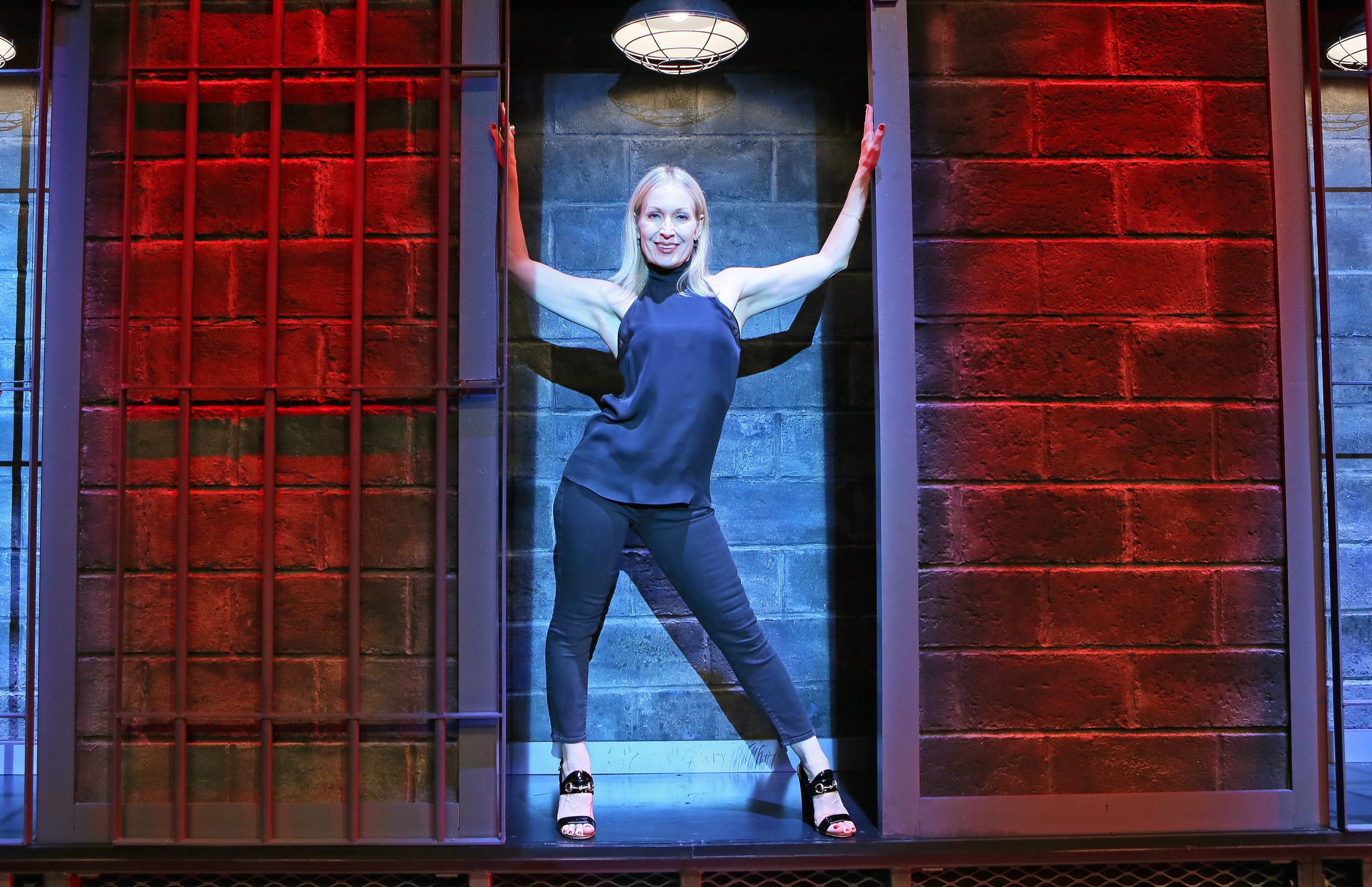Buffalo native Marguerite Derricks stands inside a set design from Cell Block Tango (from 'Chicago') after a performance of 'ShowStoppers' at Wynn hotel-casino in Las Vegas. (Ronda Churchill/Special to The News)