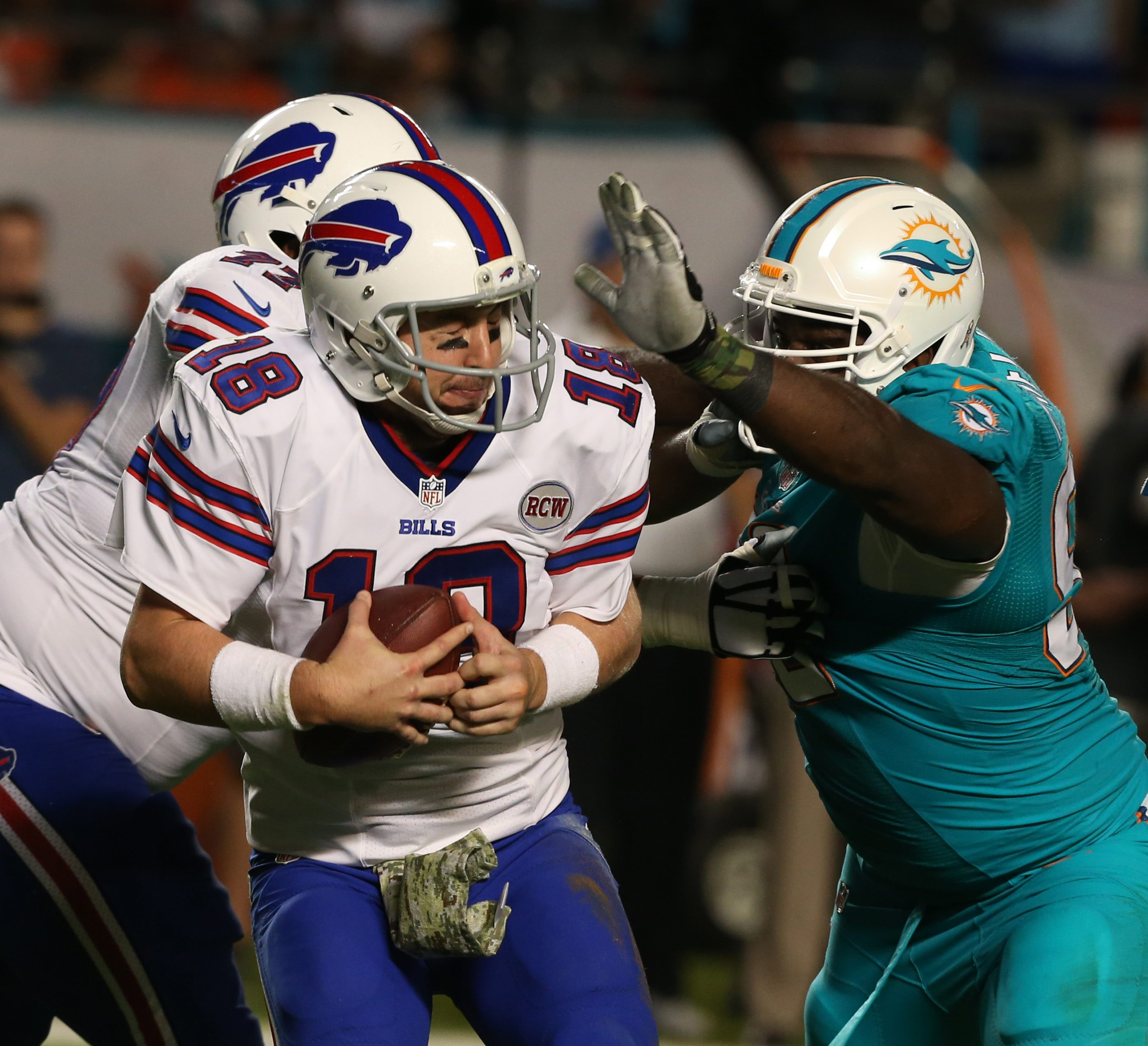 Buffalo Bills quarterback Kyle Orton (18) is sacked by Miami Dolphins defensive tackle Earl Mitchell (90) in the fourth quarter of the Bills' 2014 loss in Miami. (James P. McCoy/ Buffalo News)